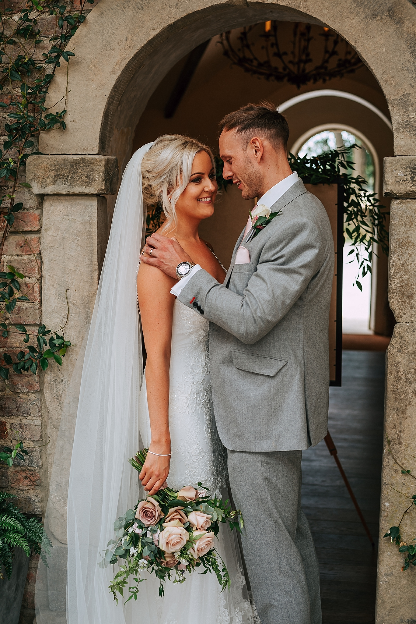 beautiful bride and groom inside the fig house at middleton lodge estate