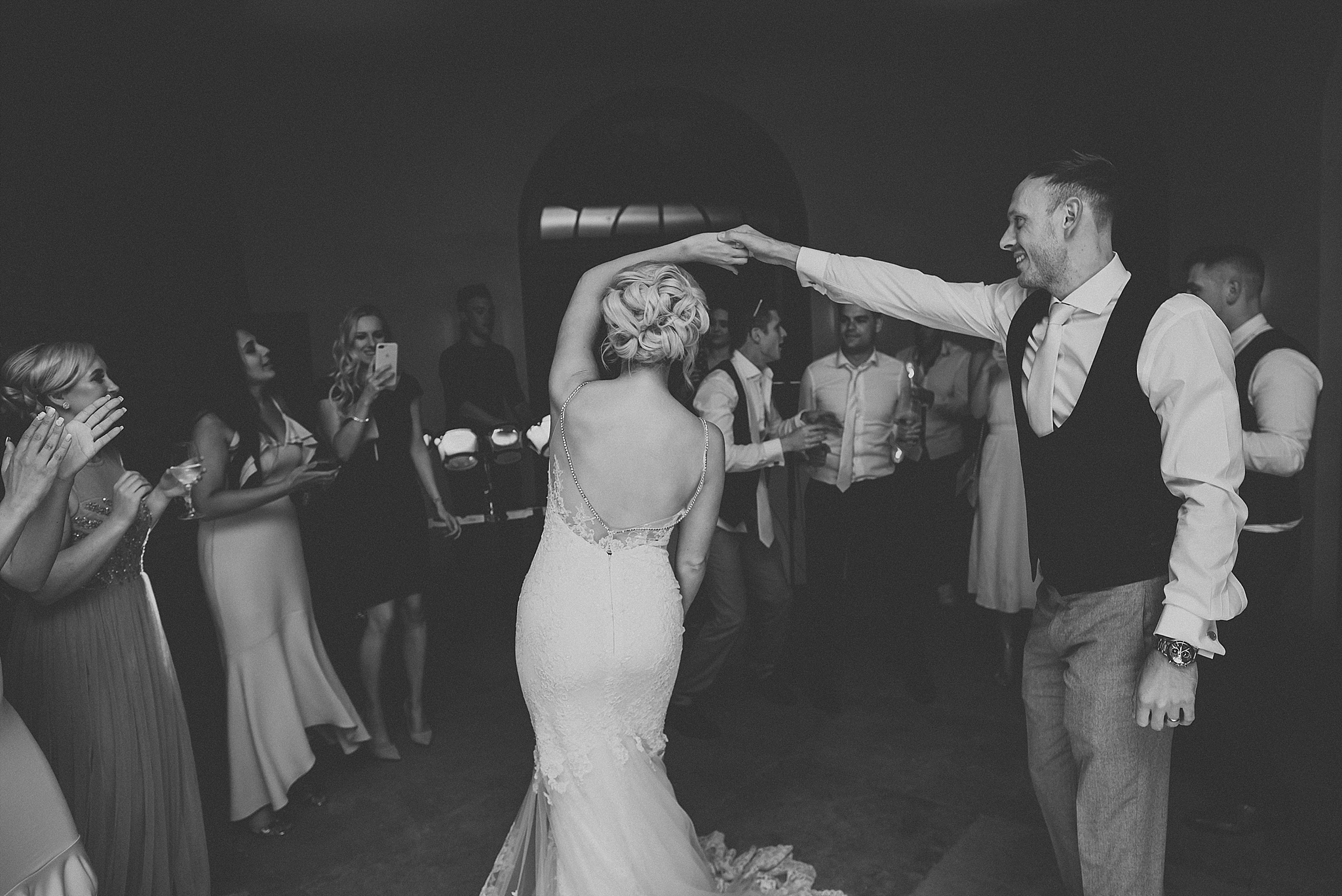 bride and groom on dance floor at the fig house