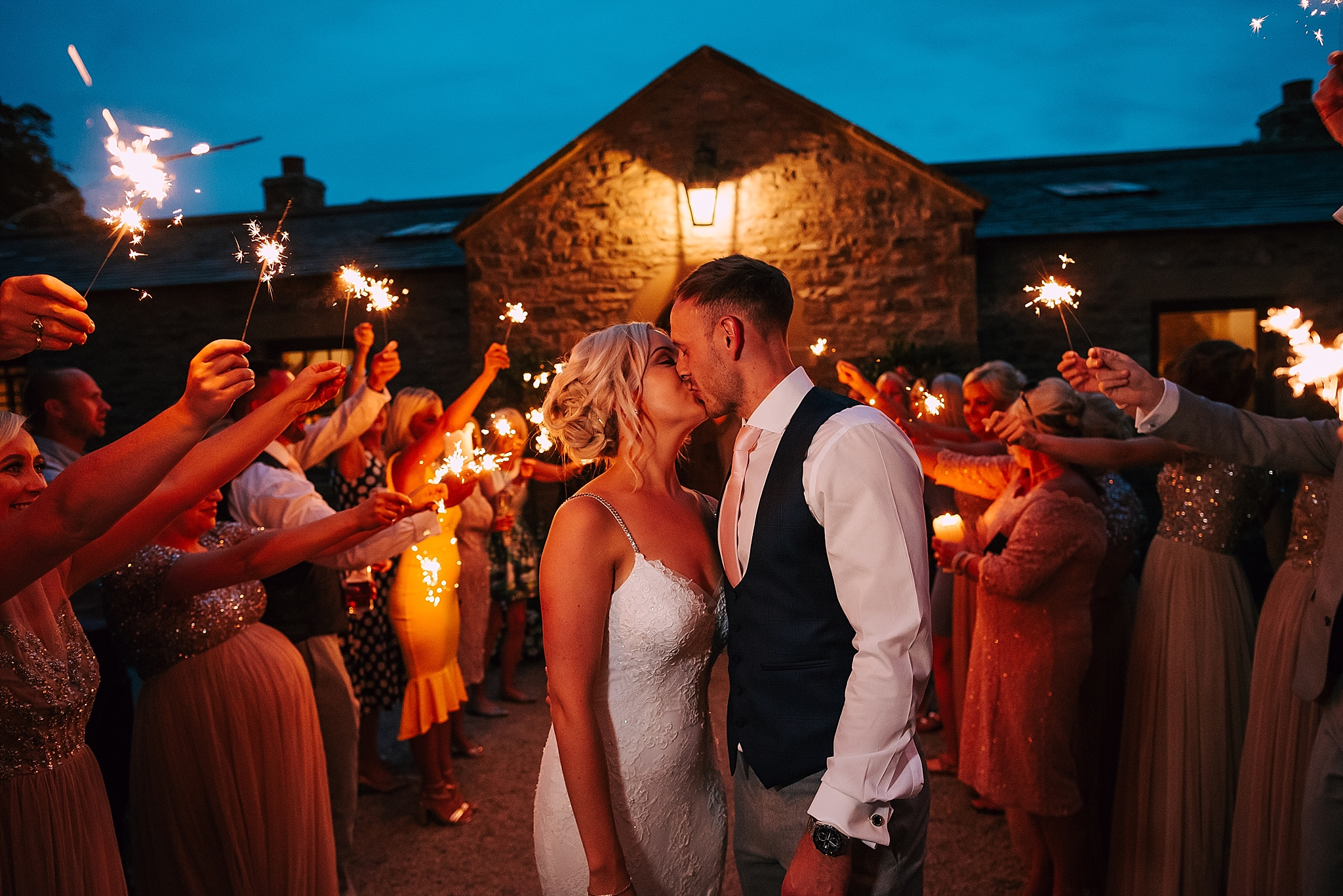 wedding couple with sparklers outside the fig house