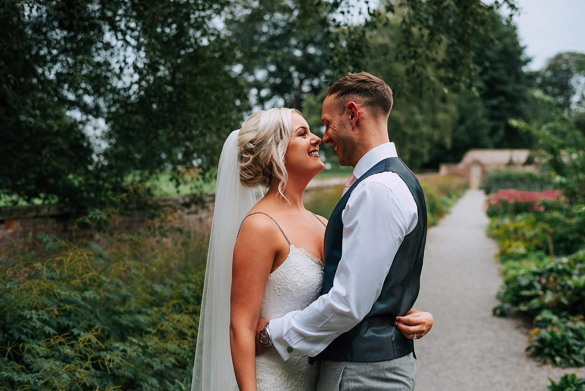 bride and groom in kitchen garden at the fig house
