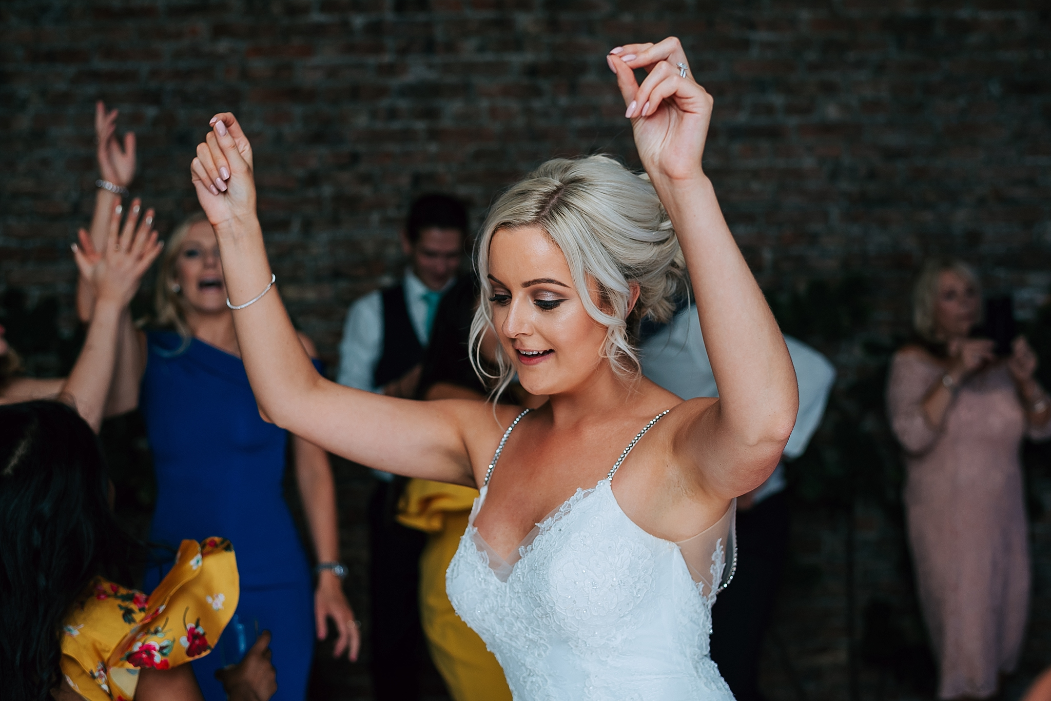 bride dancing at her wedding at the fig house