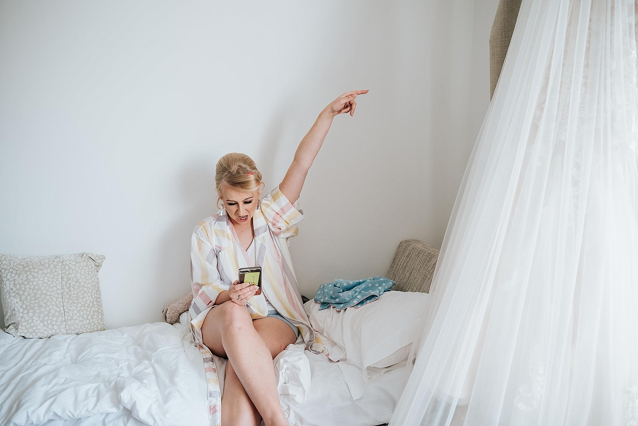 blonde bride in pyjamas before wedding
