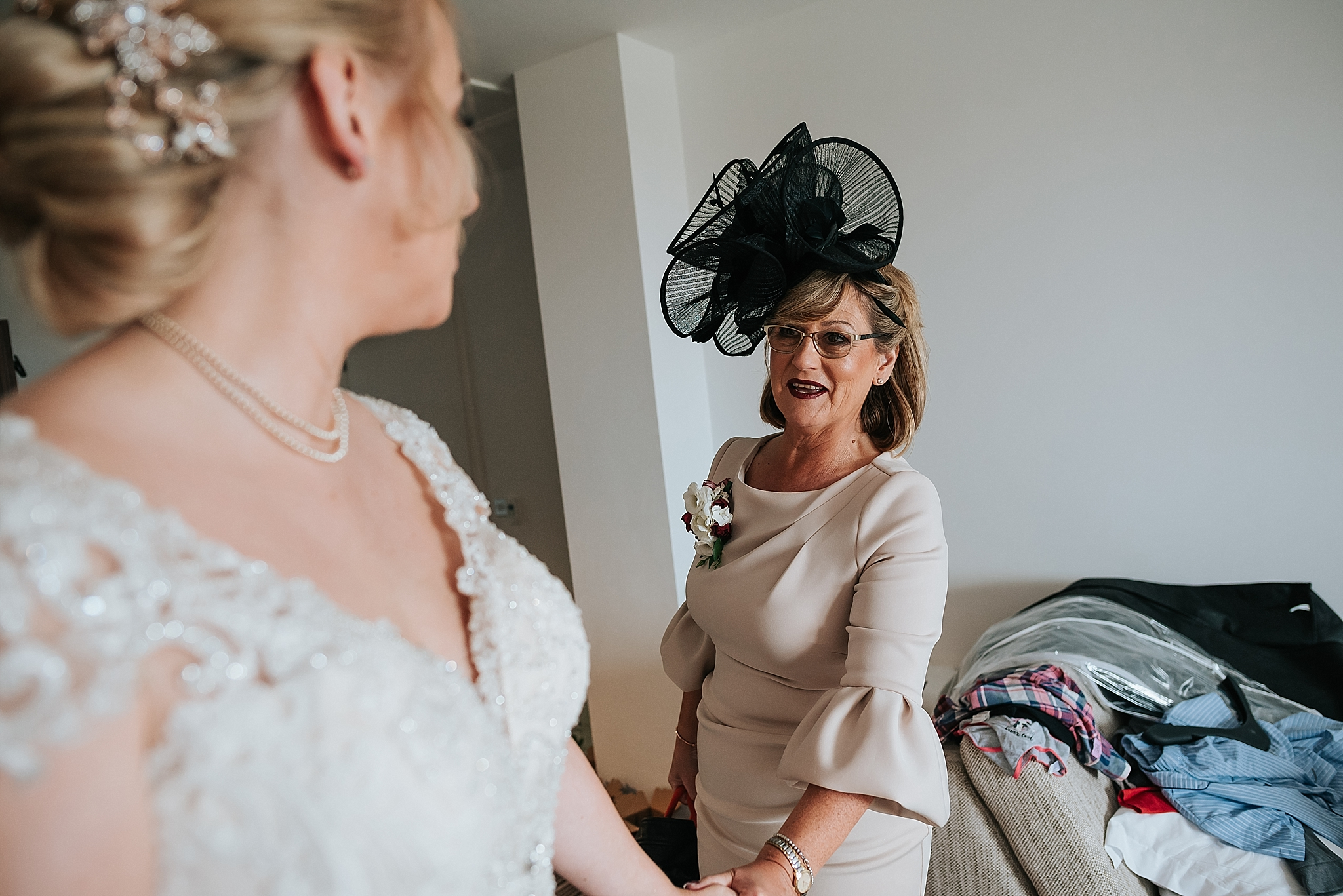 mum holds brides hand at the grand, st annes