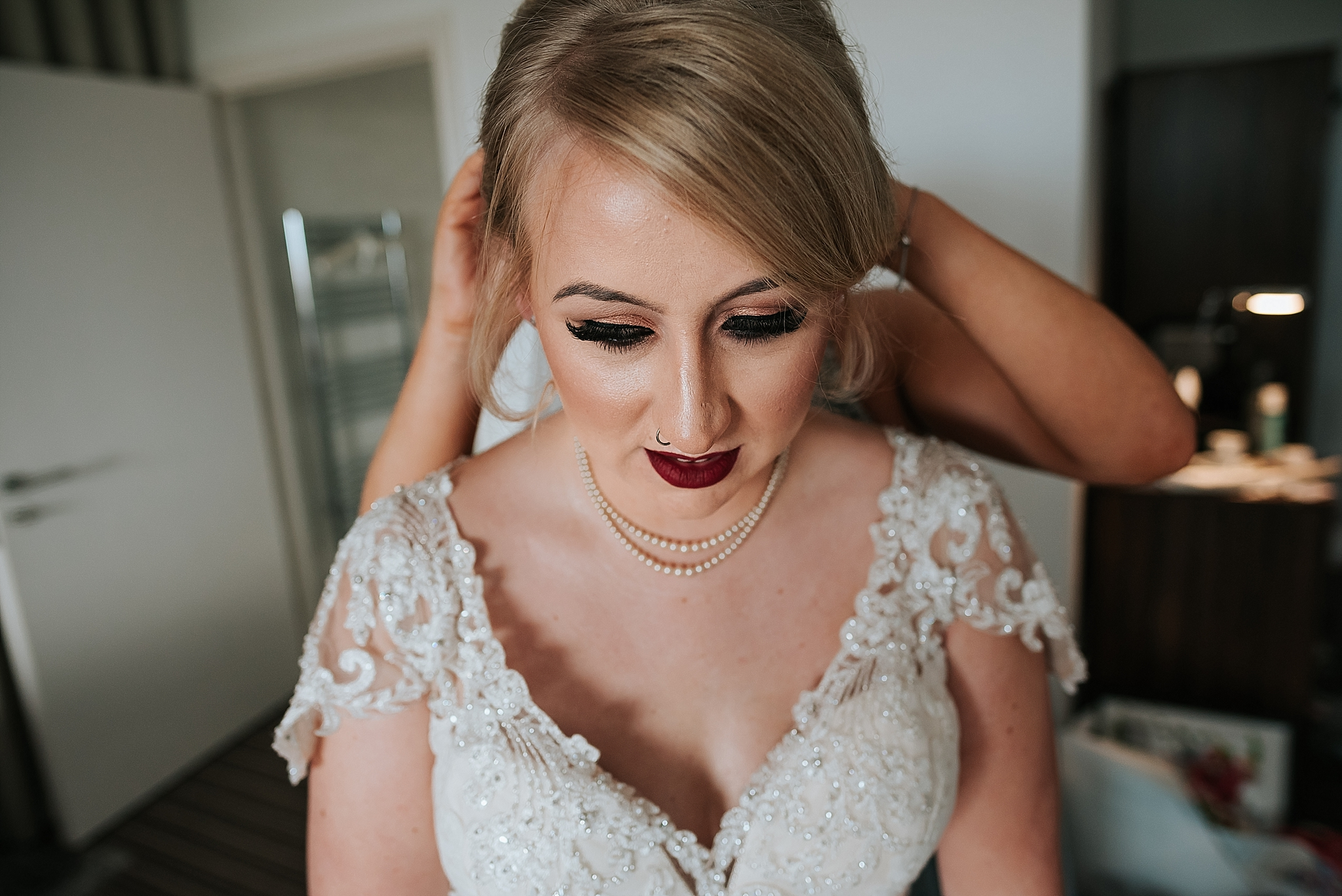 bride has wedding vale put in her hair at the grand 22 st annes