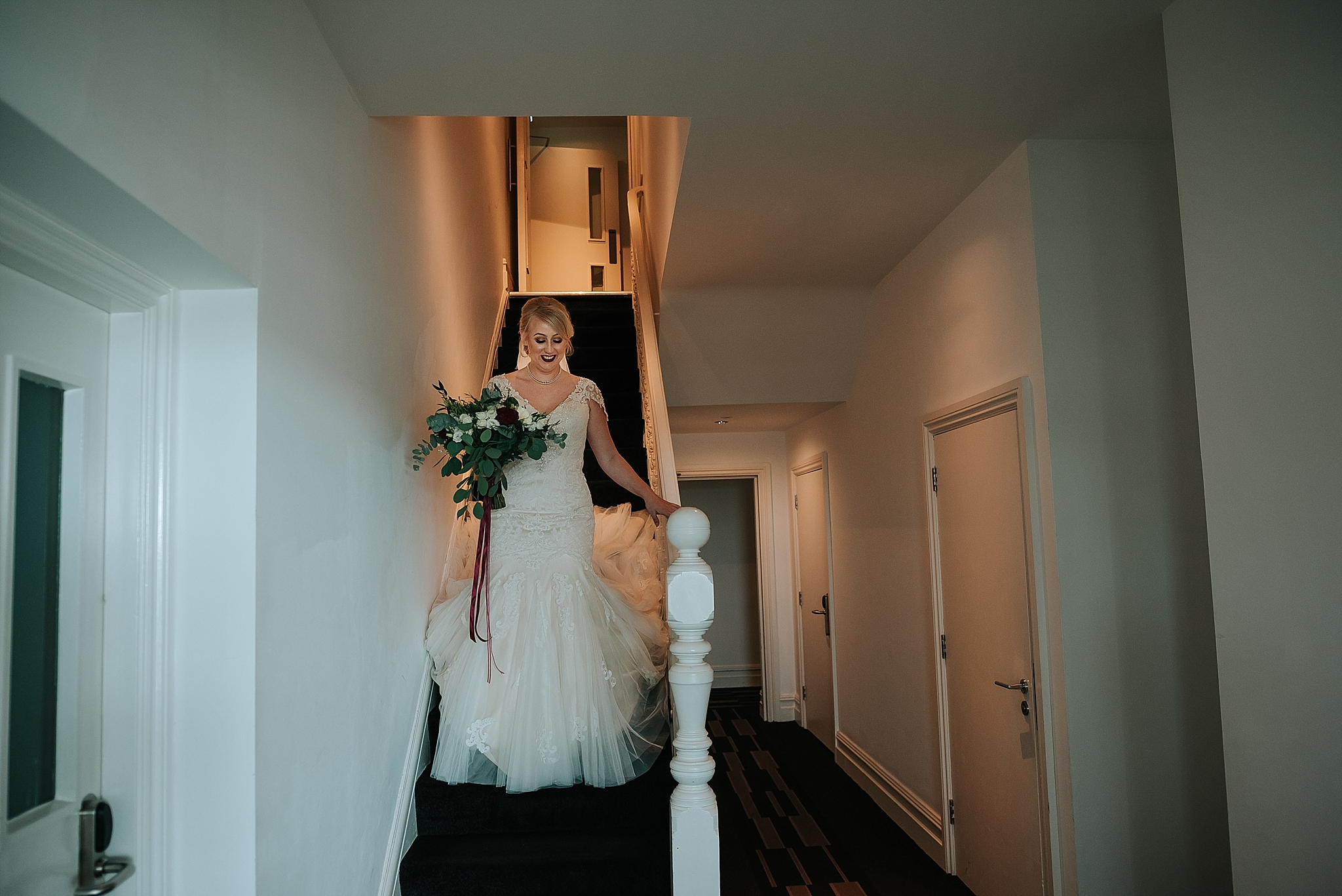 bride walking down the stairs at the grand hotel in lytham st annes