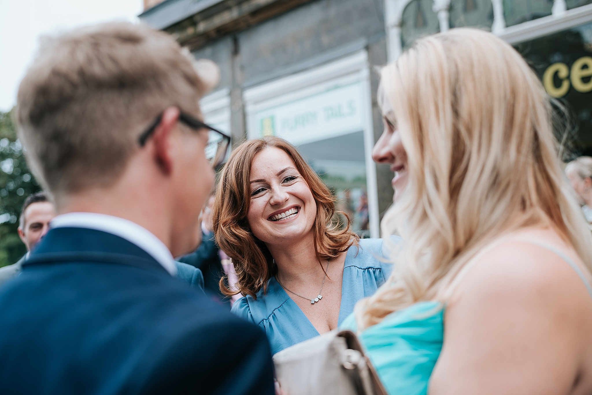 woman laughing outside st annes palace wedding venue