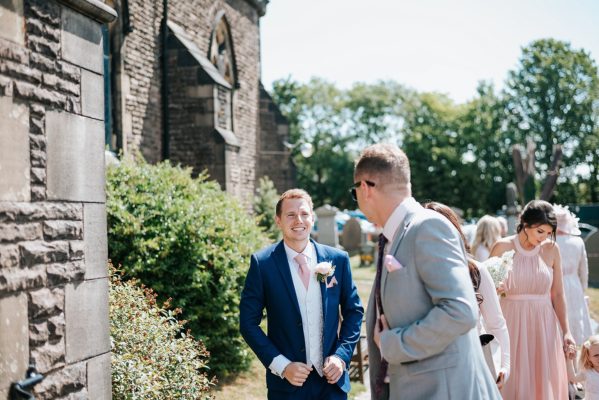 groom chatting to guests at wedding