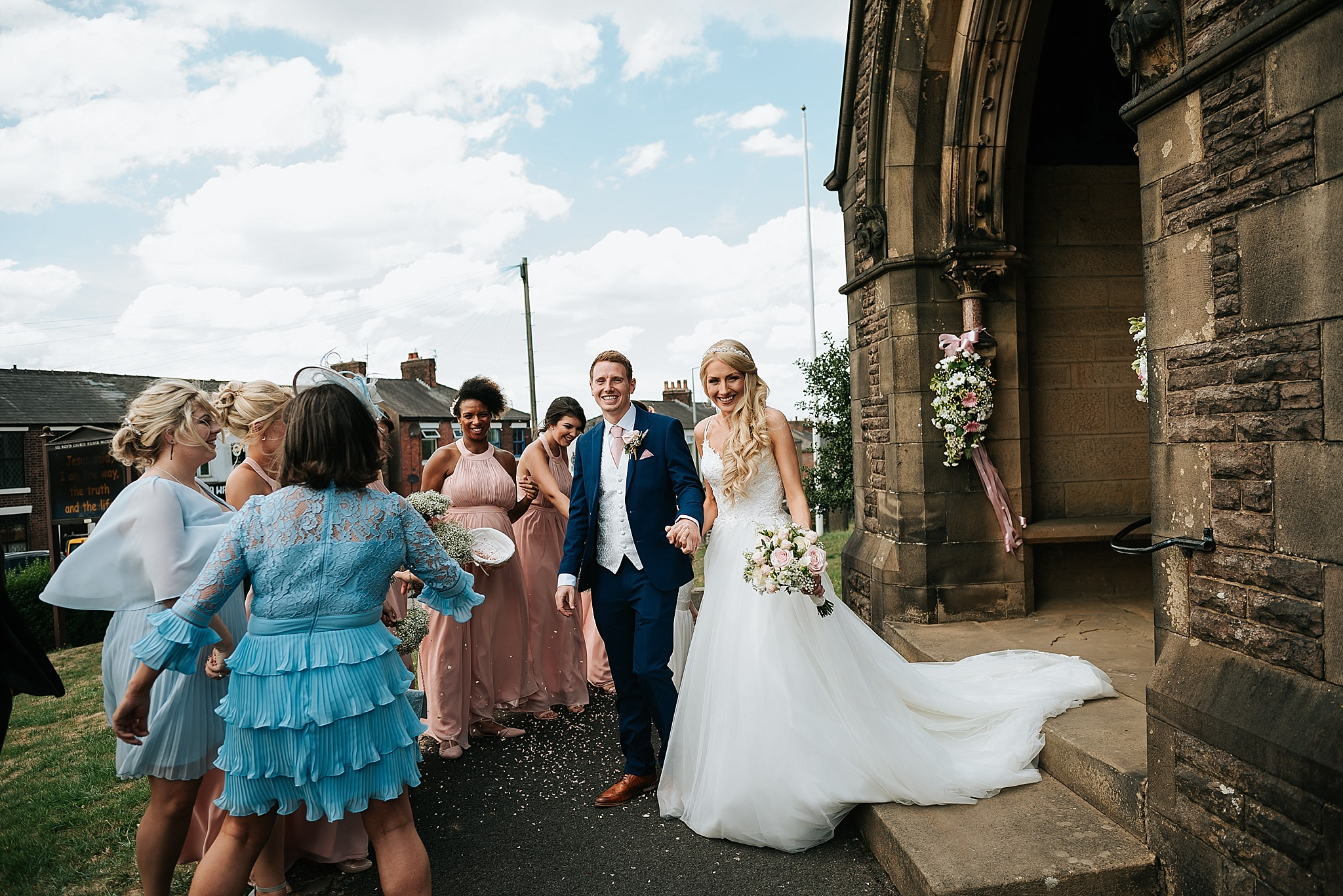 couple leave church after wedding