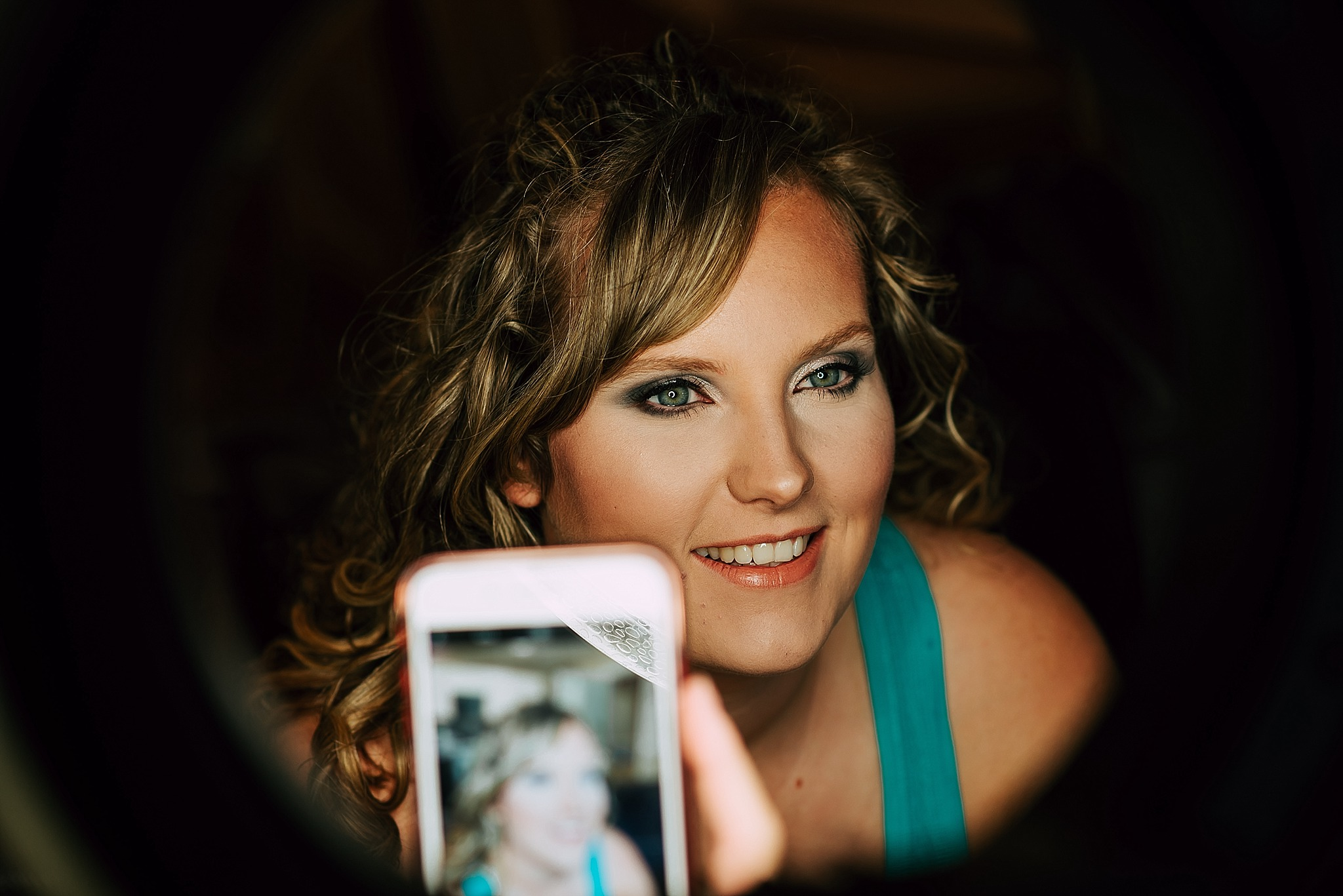 bride has make up done for wedding
