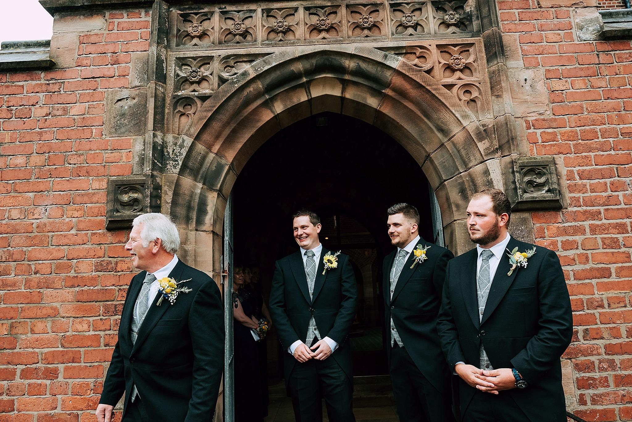 groomsmen wait for bride at christ church in wesham