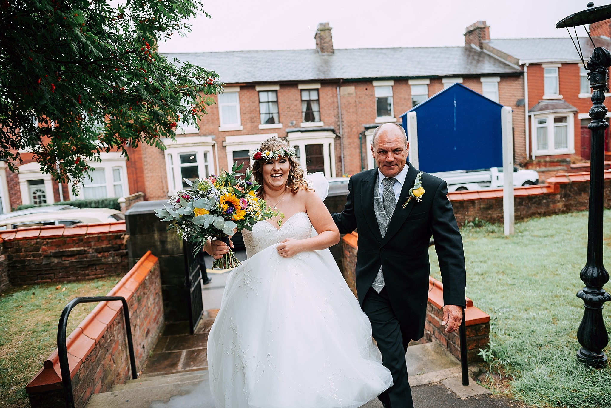 bride and her dad walk up path at christ church wesham