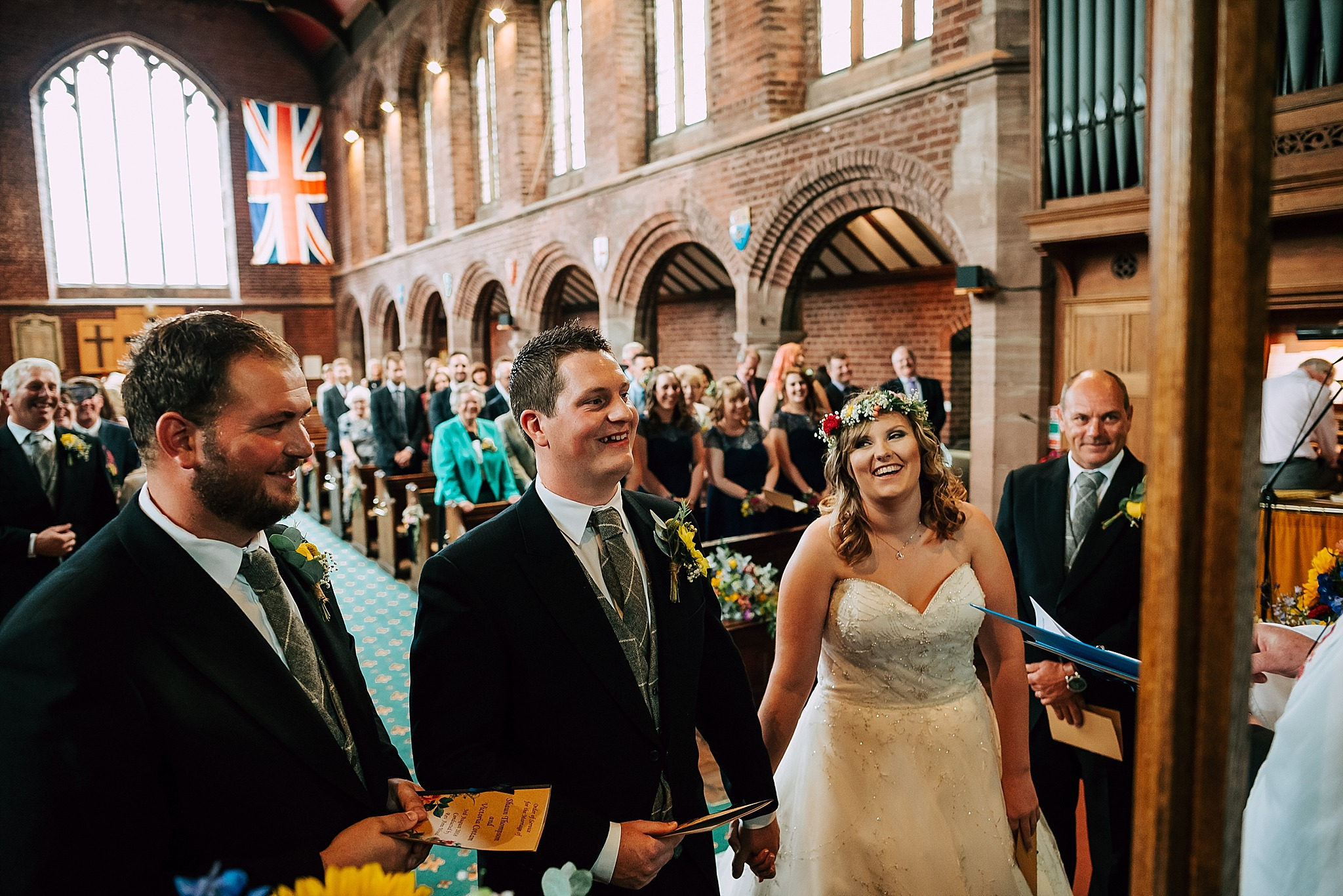 bride and groom laughing at wedding at christ church