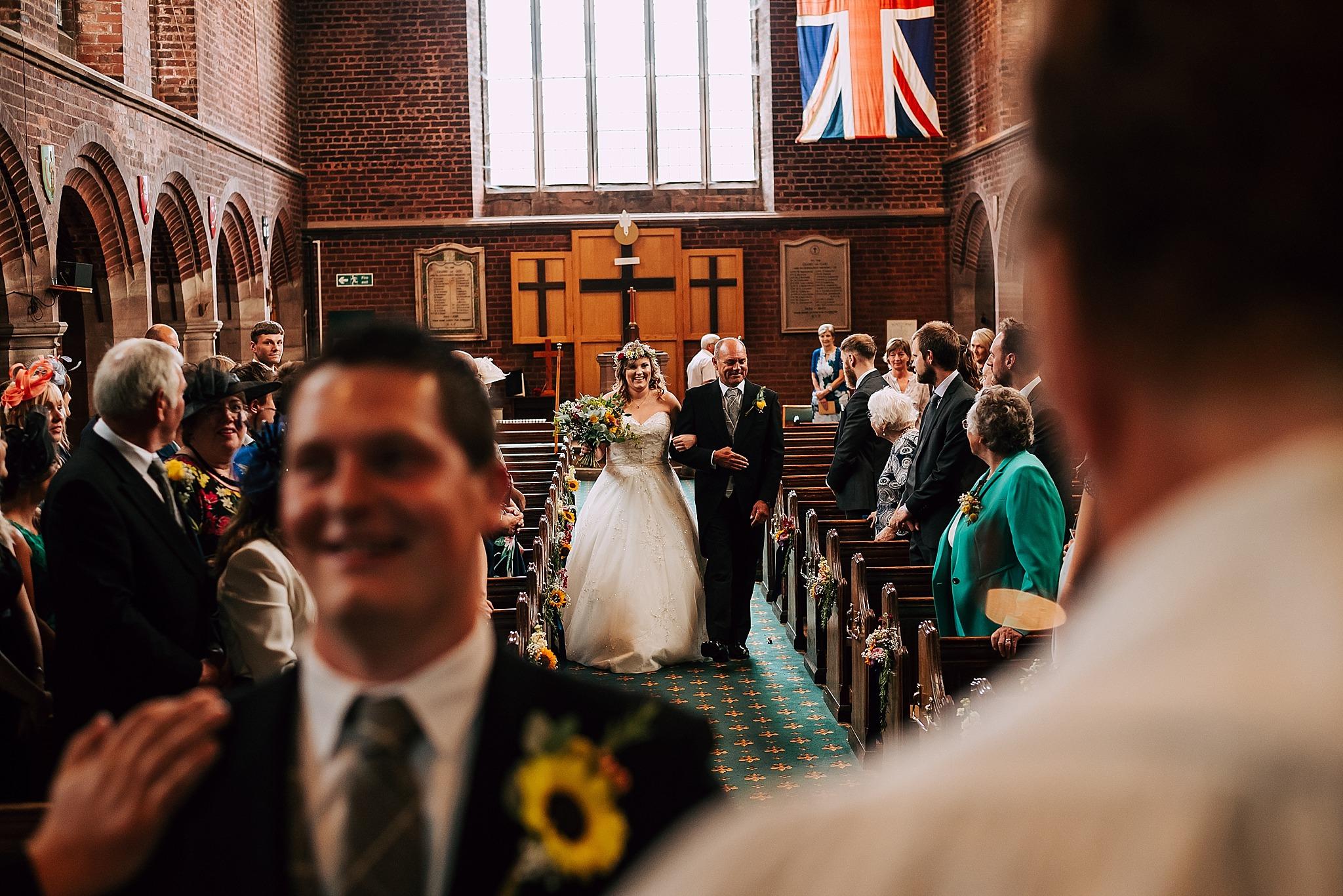 bride walking down the aisle at christ church wesham