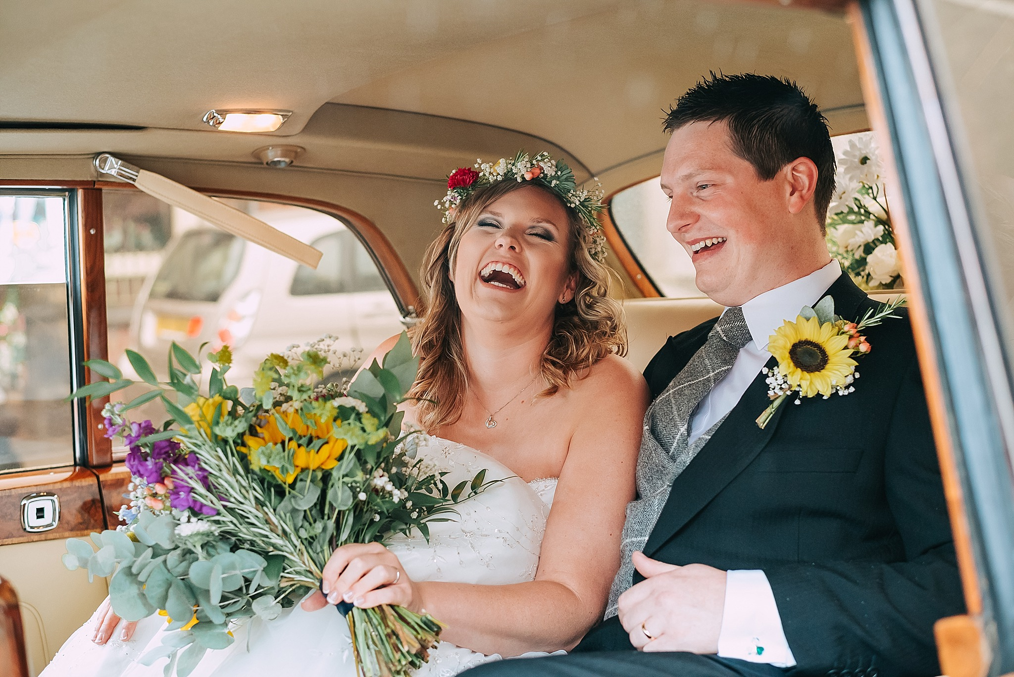 happy bride in wedding car on fylde coast