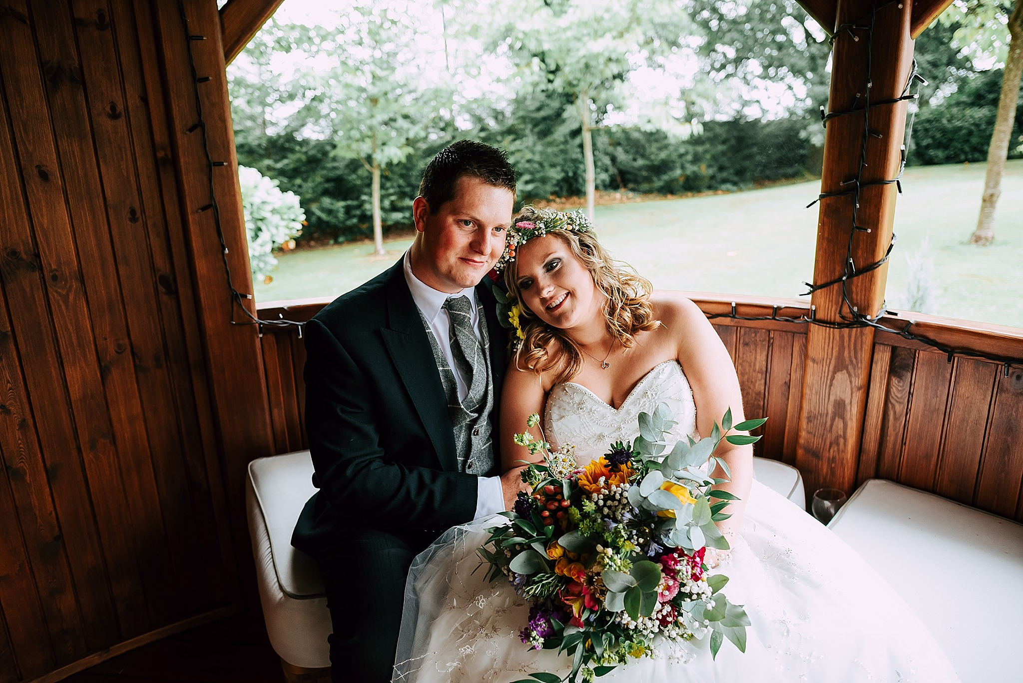 bride and groom in the gardens at ribby hall village
