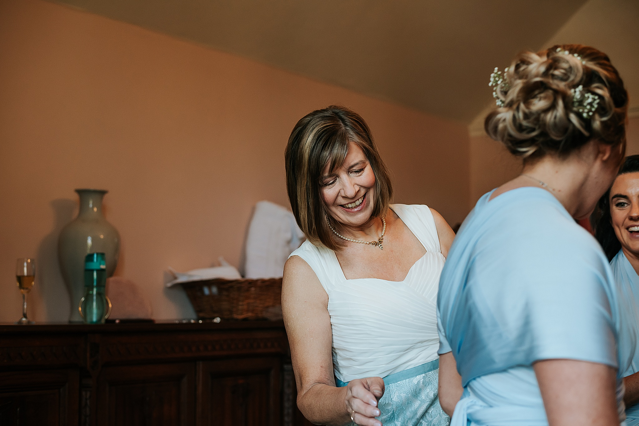 mother of the bride getting ready for wedding near preston