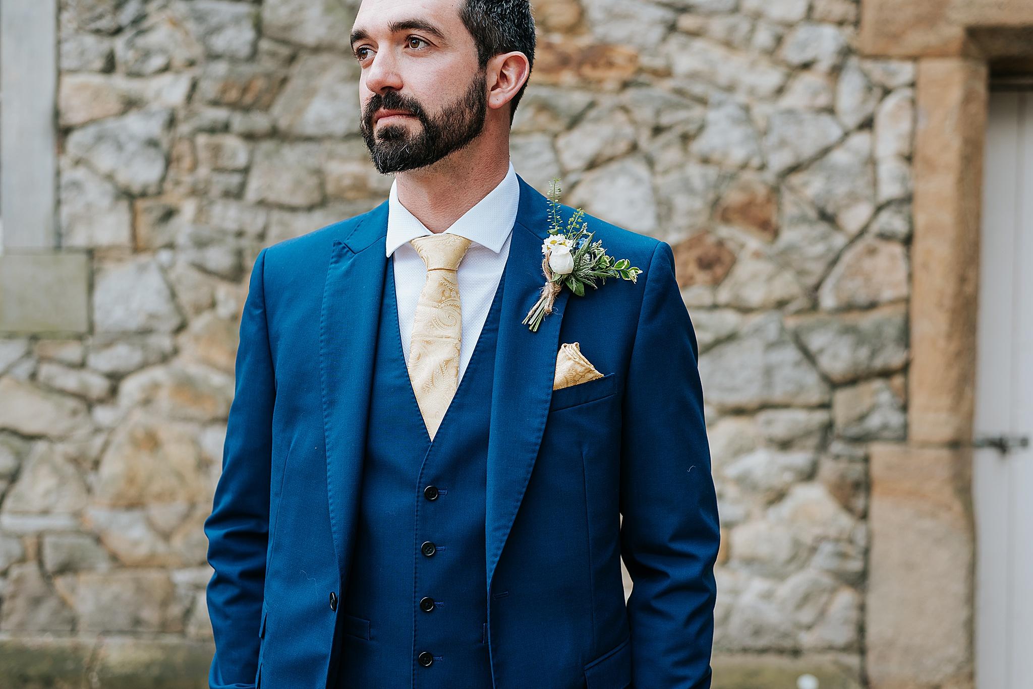 groom ready for barn wedding