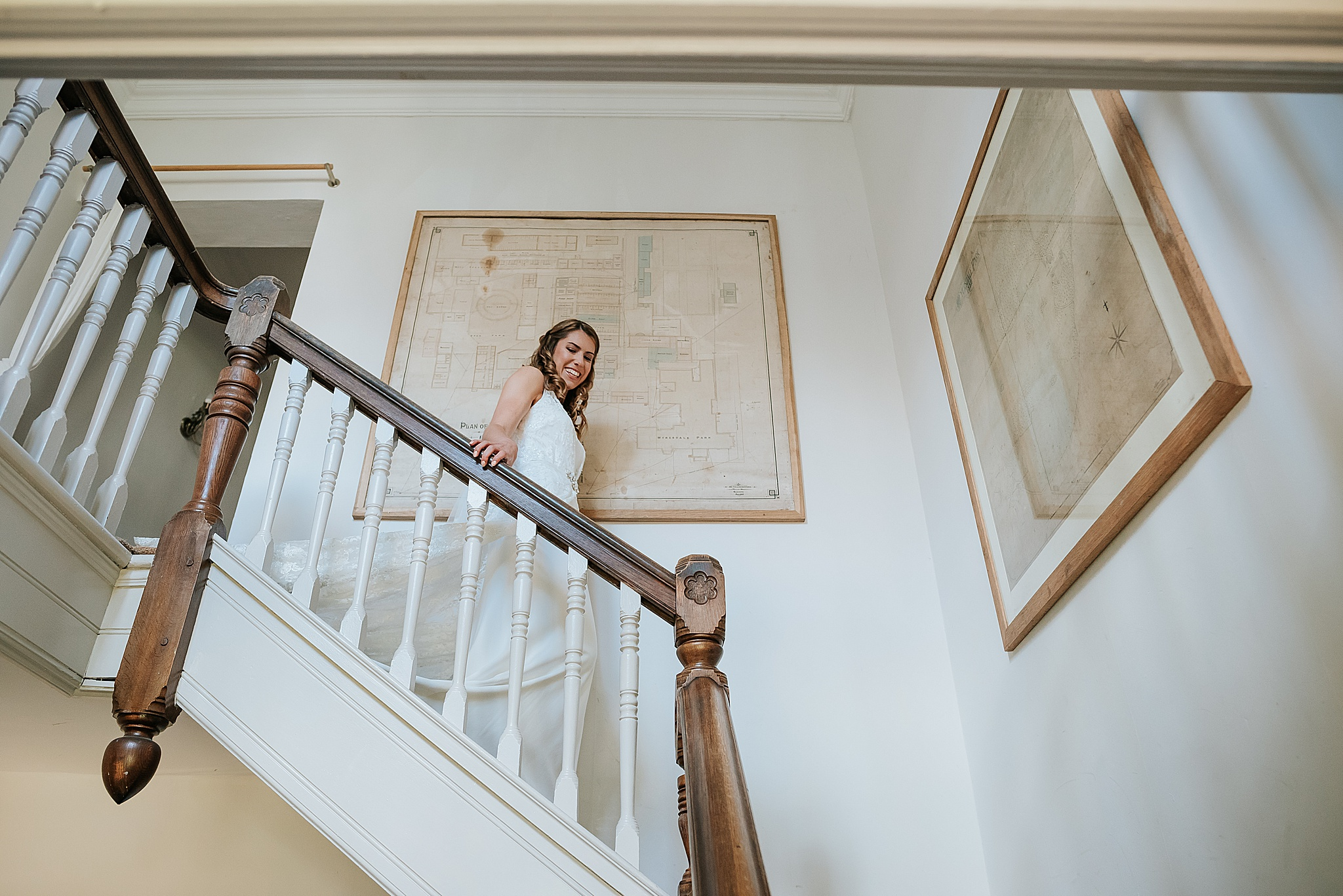 bride walks down main staircase at wyresdale park