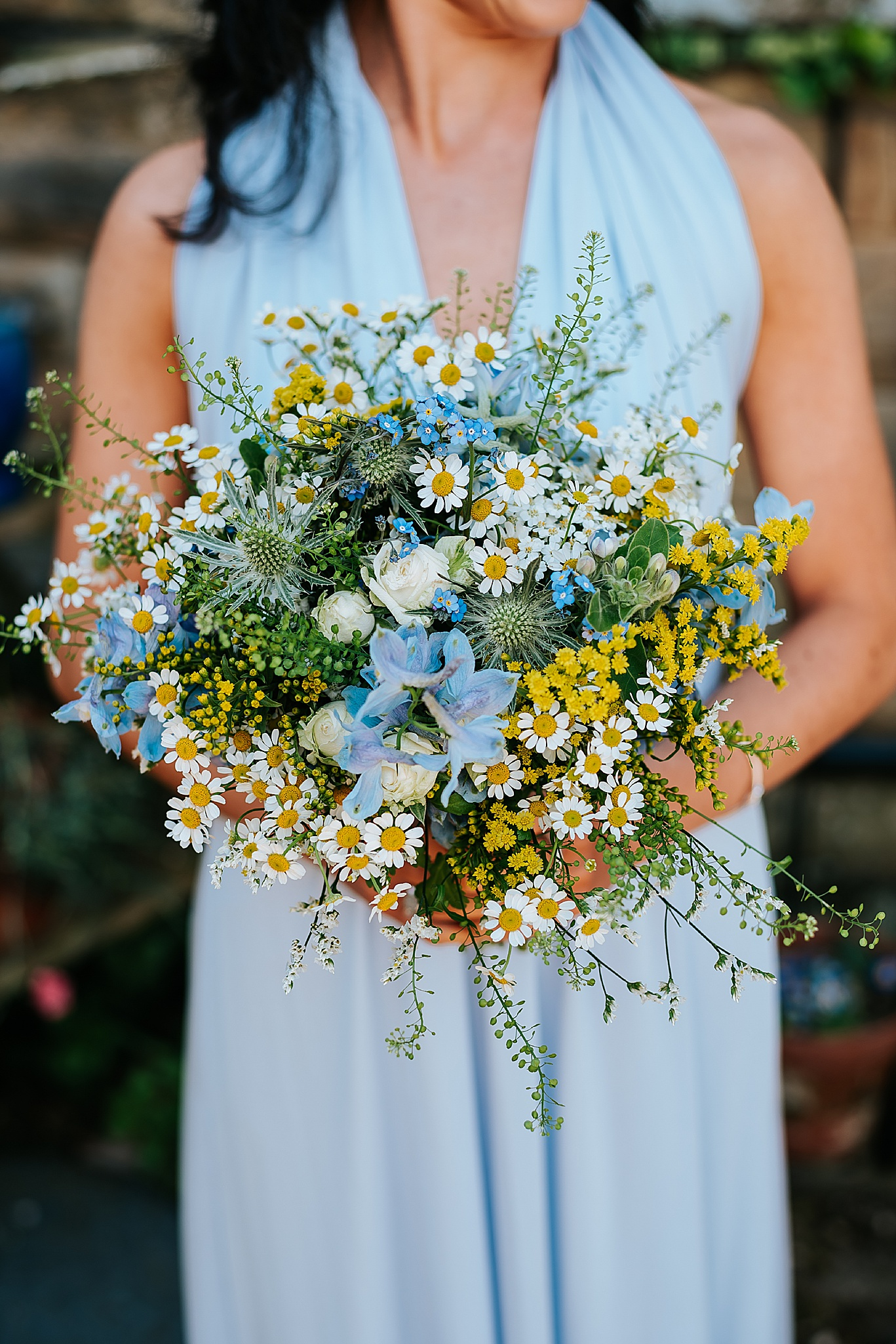spring wedding bouquet by bluebells and daisies