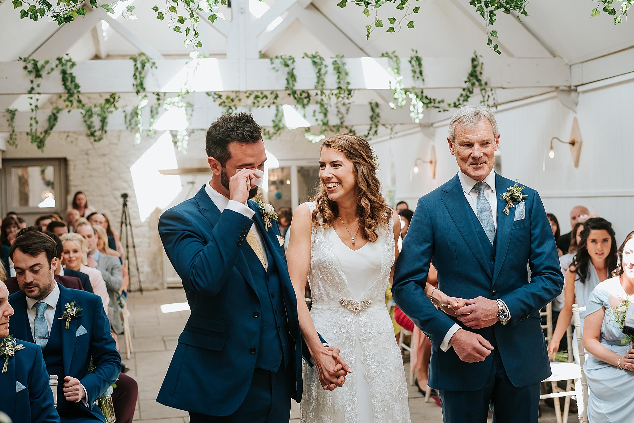 bride and groom at preston barn wedding venue
