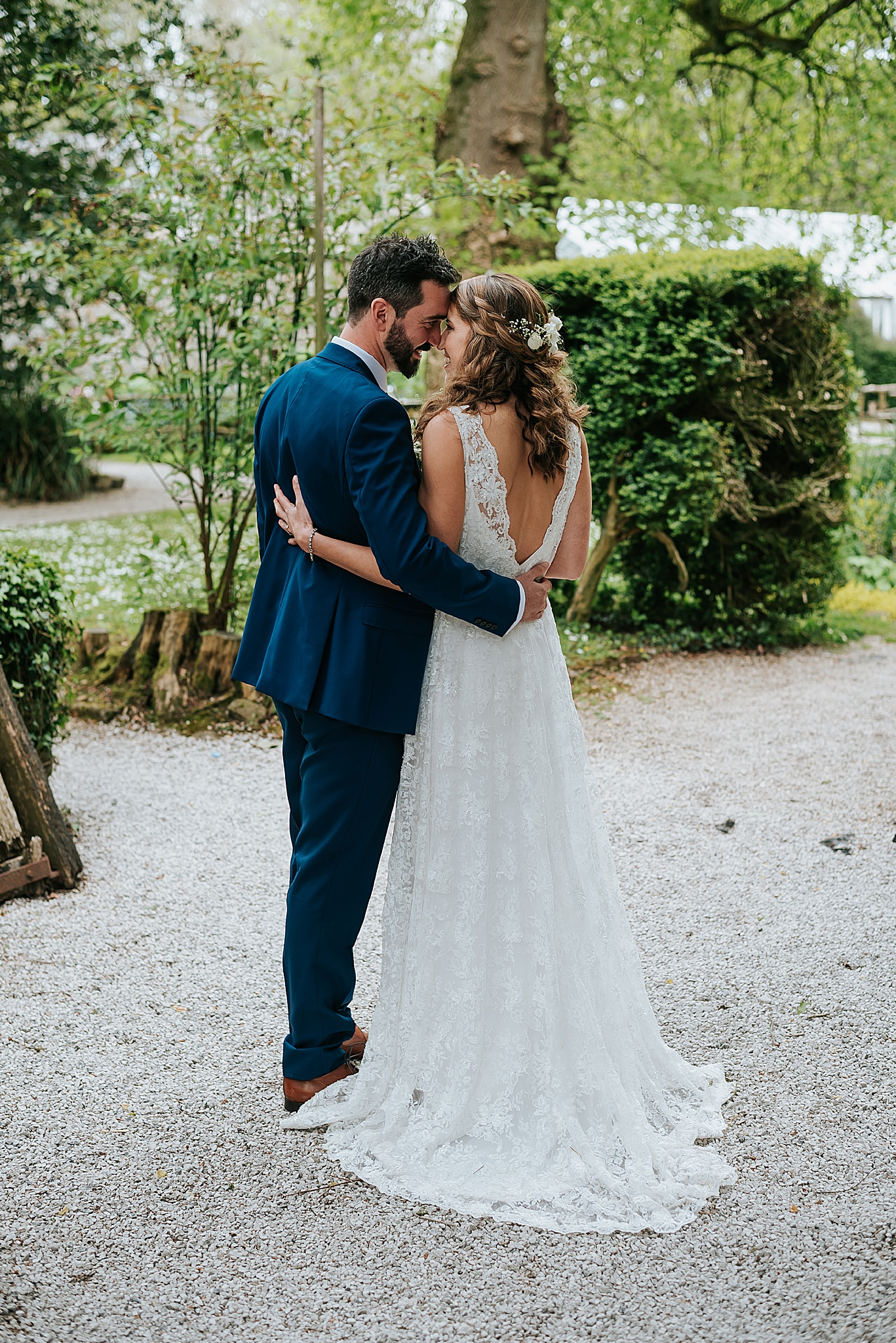 bride and groom kissing at relaxed wedding at wyresdale park