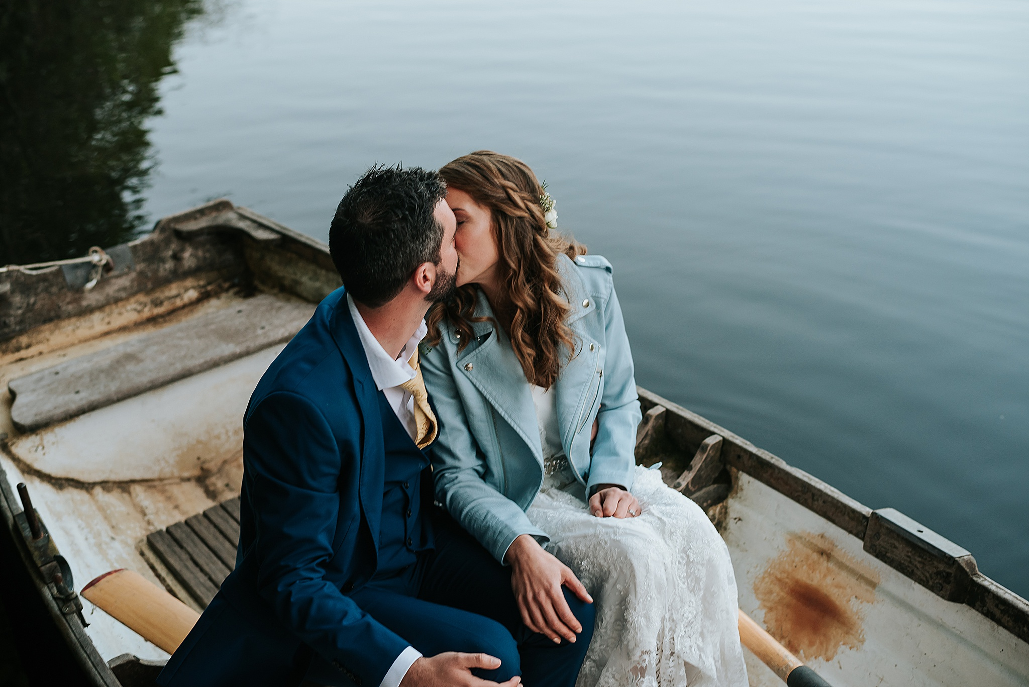 wedding couple on the boat on the lake at qyresdale park