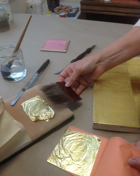 Basic gilding tools used in the transfer and application of gold leaf.