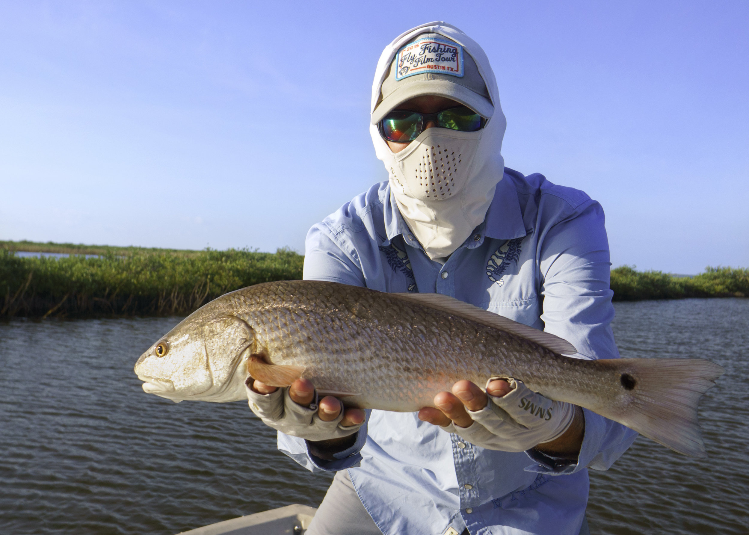 Chris Koch with a nice Texas Redfish on the fly