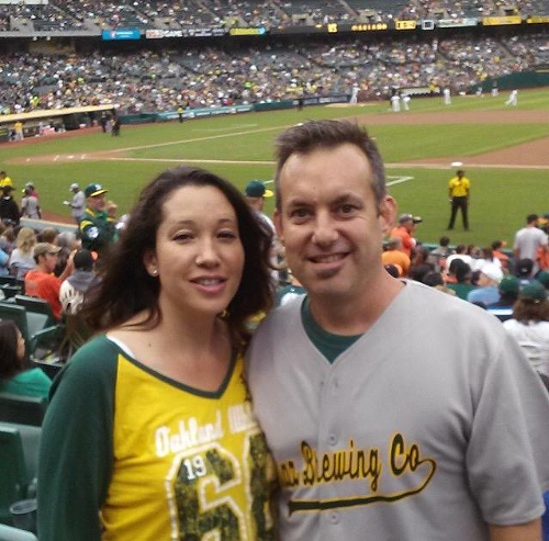 Chris and wife Heidi at an A's game. Chris showing his A's and Mraz pride!