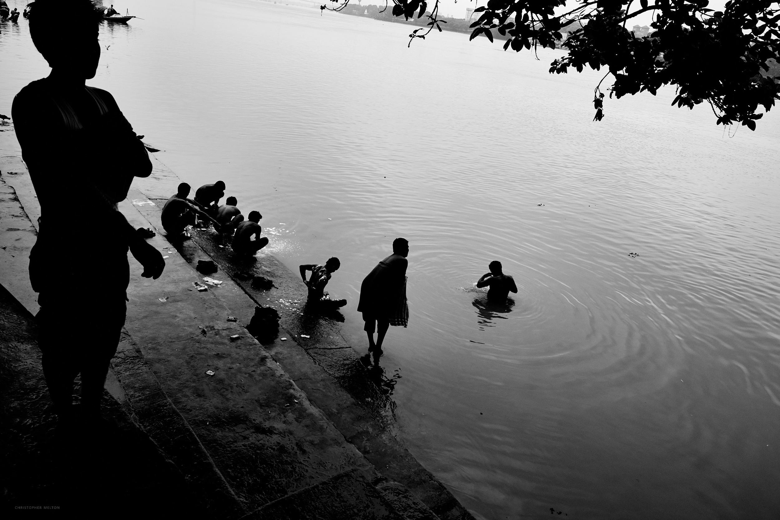 Bathers under the Howra, Mallick Ghat, Kolkata.