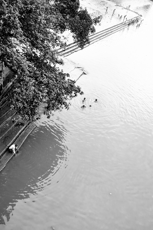 Mallick Ghat with bathers, Kolkata.