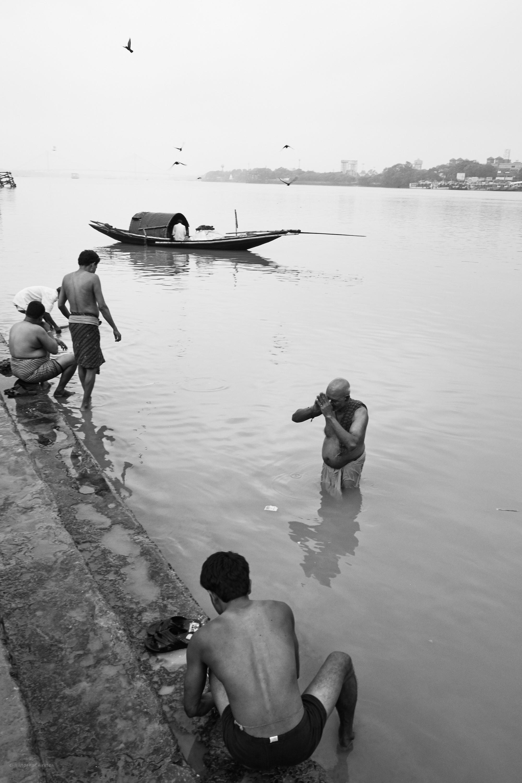 Morning devotion, Mallick Ghat, Kolkata.