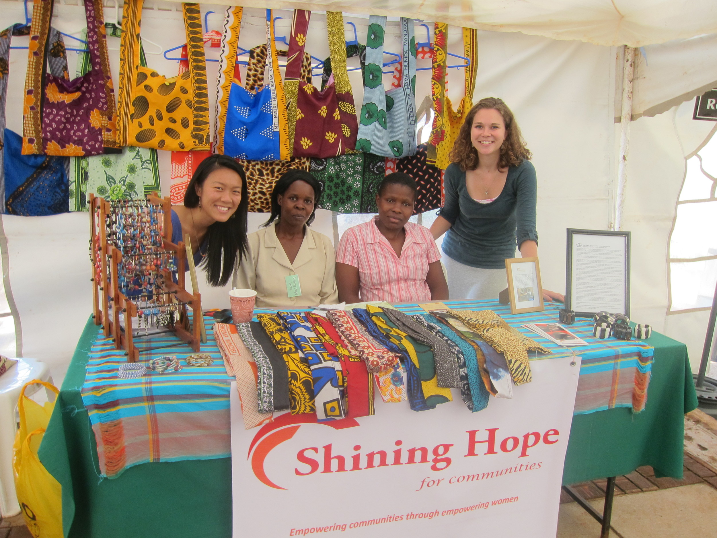 Xiaoxi, Shining Hope's Manager of Strategic Partnerships, along with Rose, Joan, and Jessica, a Shining Hope fellow