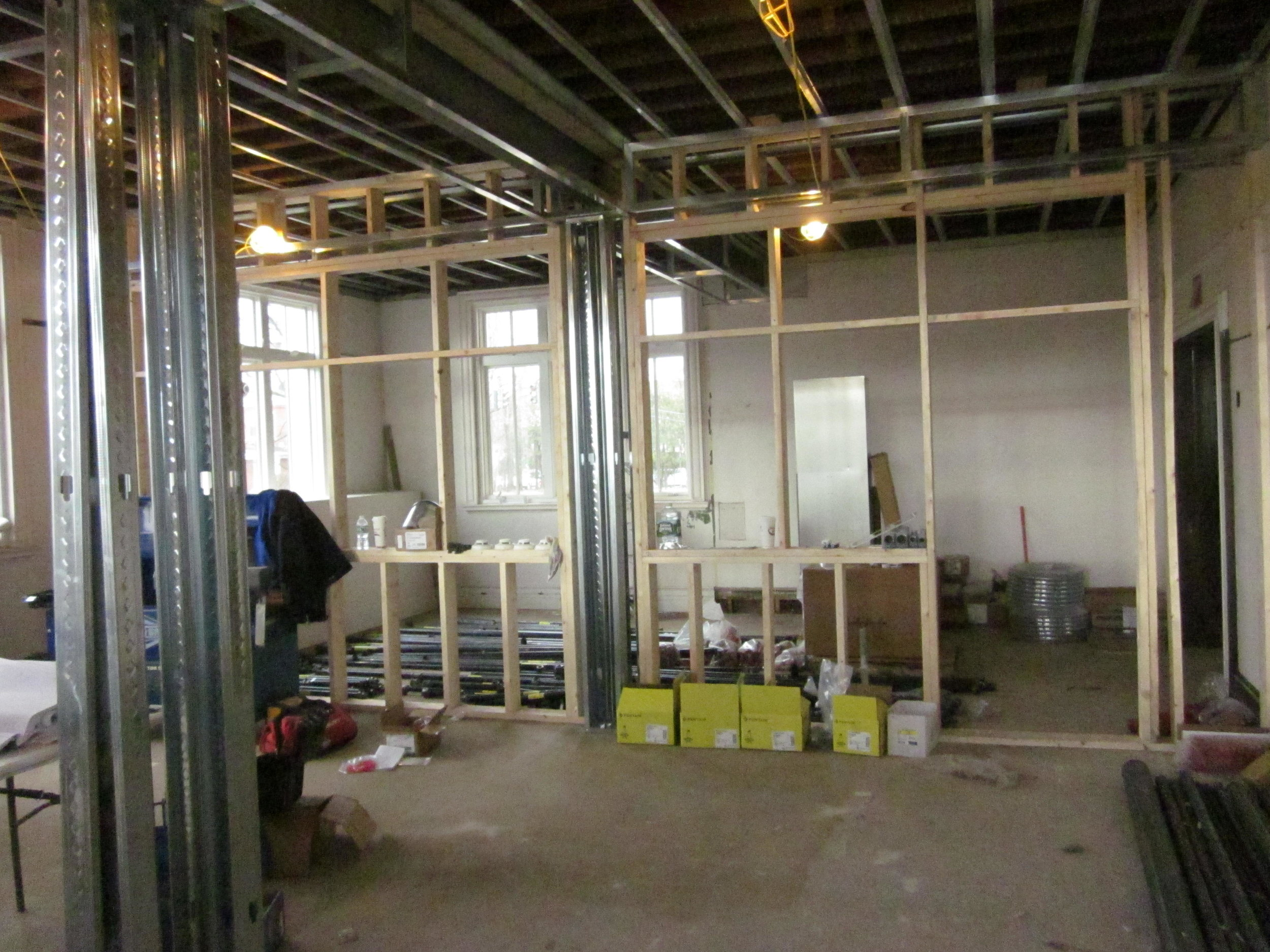 Framing in a new wall to create the new local history room and a reading room.