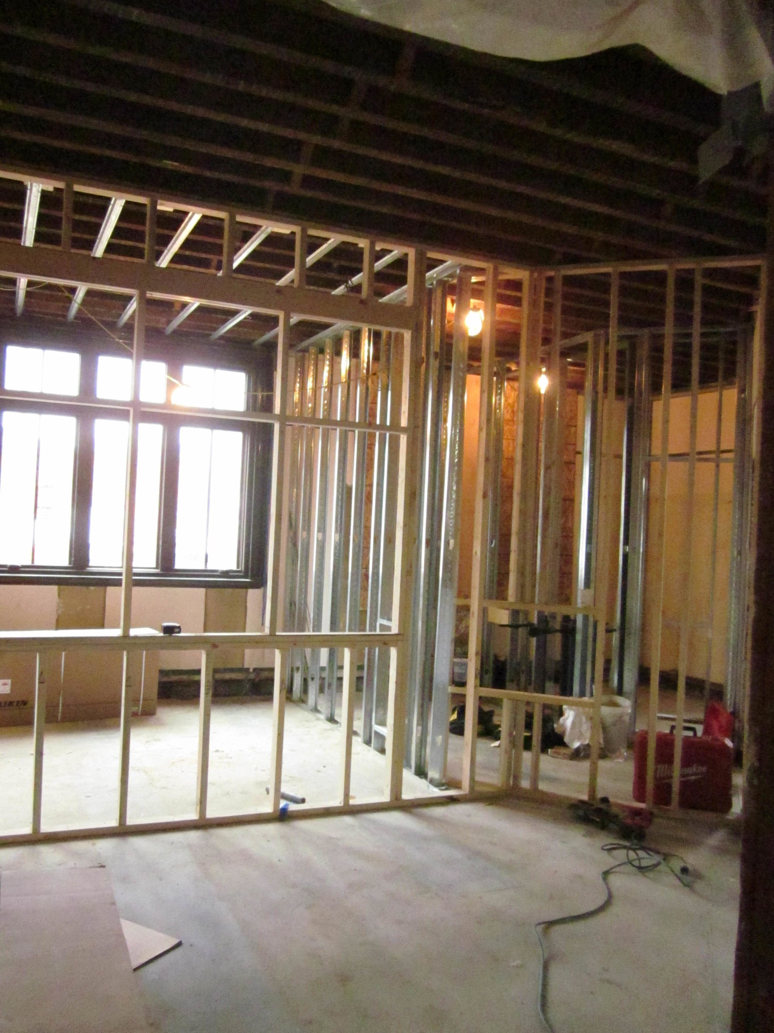 New staff workroom in former nonfiction room. New small meeting room to left and restrooms to right.