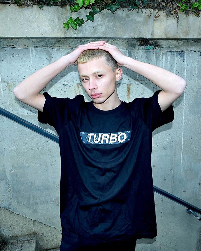 """Post-holiday mood. @papioftheyouth sporting our """"PARIS"""" s/s tee 🏳🏴🏁 #TURBOSTORE  Limited quantities available at our web shop. Link in bio"""