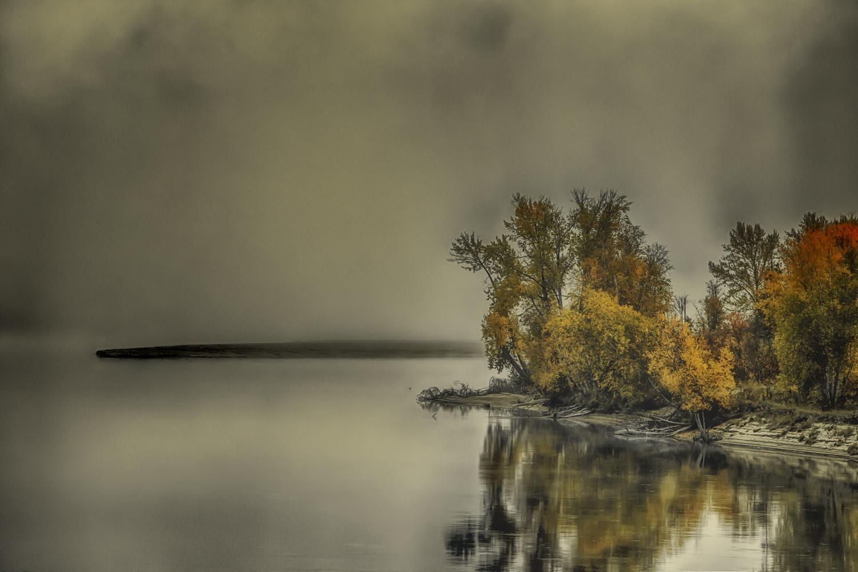 Rain and mist on a Thompson River sand bar against the brilliant fall foliage