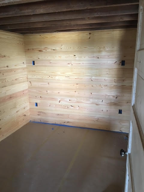 Shiplap covers the bedroom walls.