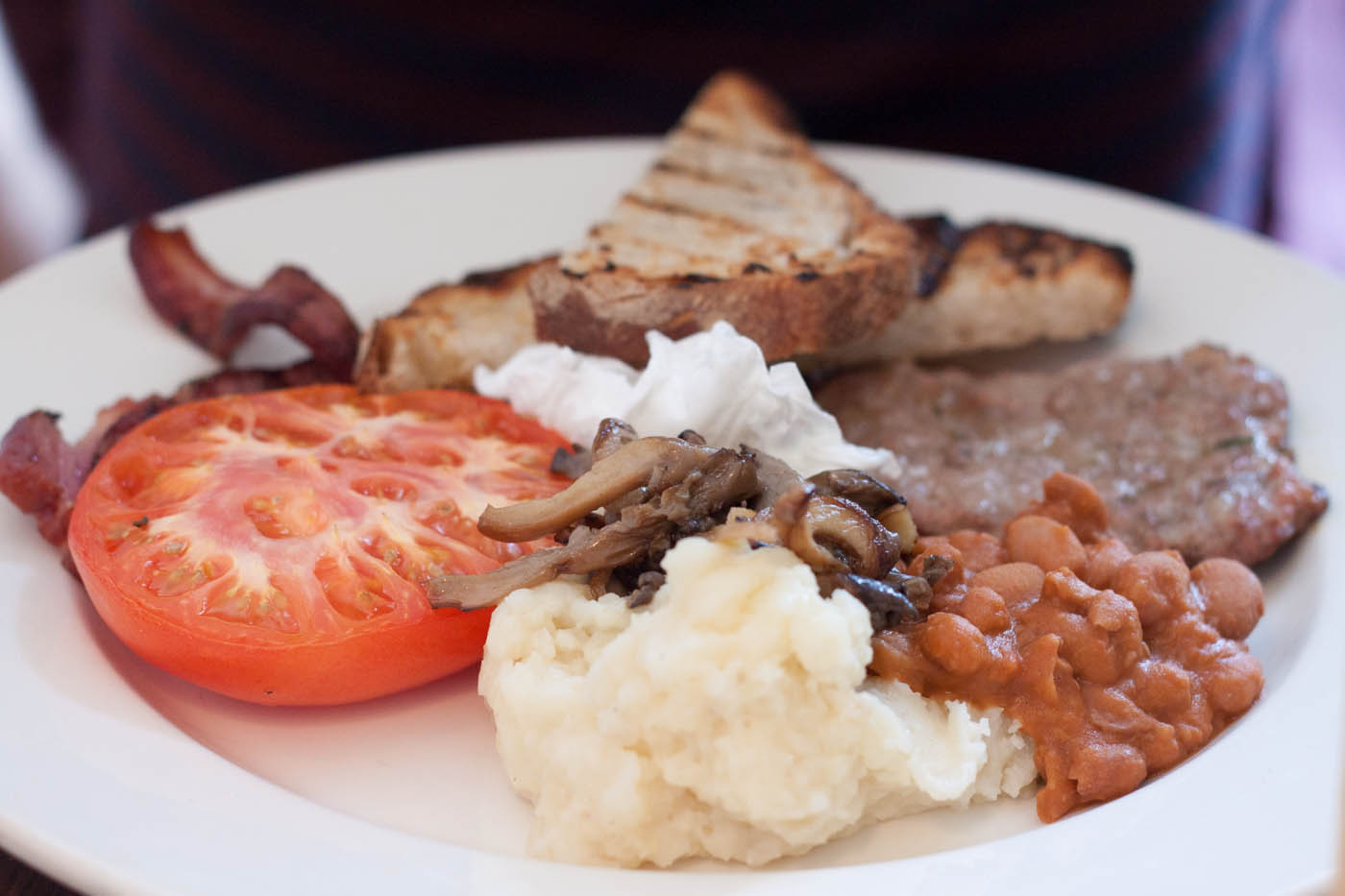 Full Homa Brunch: Dry Cured Bacon, Sardinian Sausage, Roasted Tomato,  Potato Puree with Sauté Mushroom, Baked Beans & Toasted Sourdough