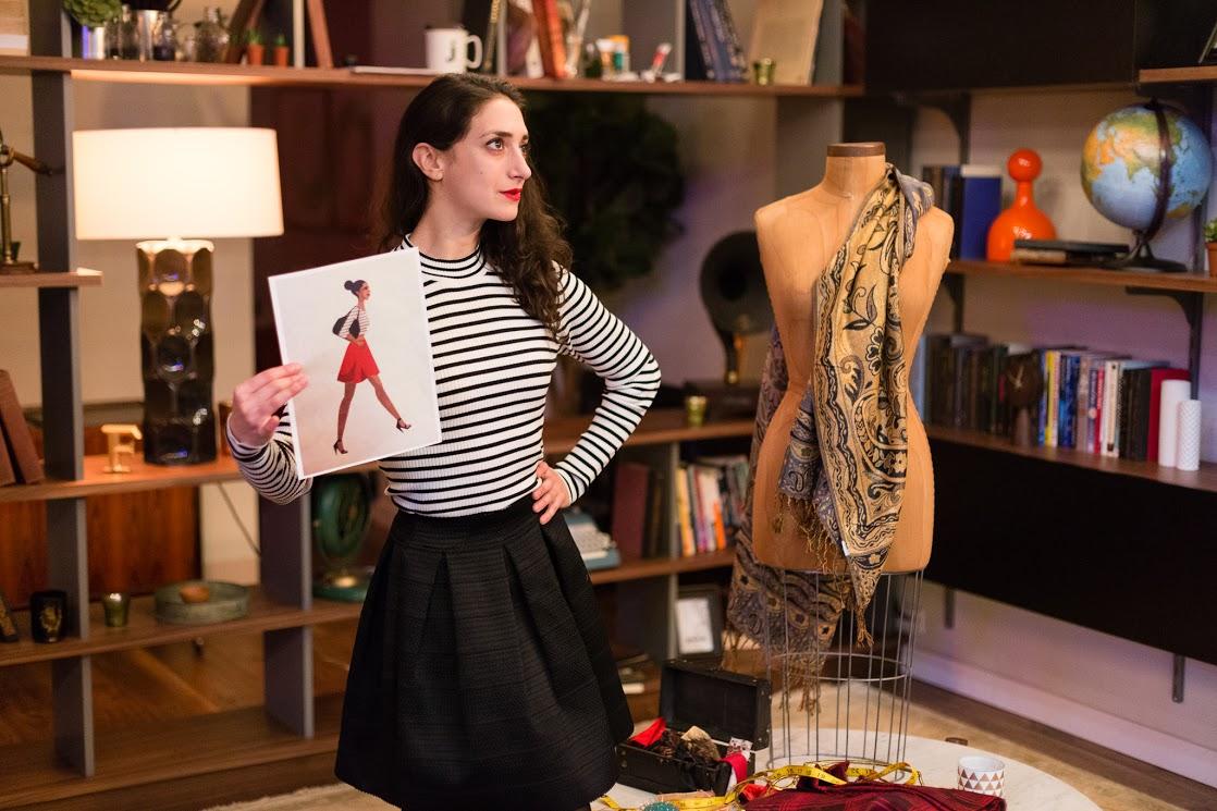 Luisa (Kayla Ernst-Alper) examines Lady's design