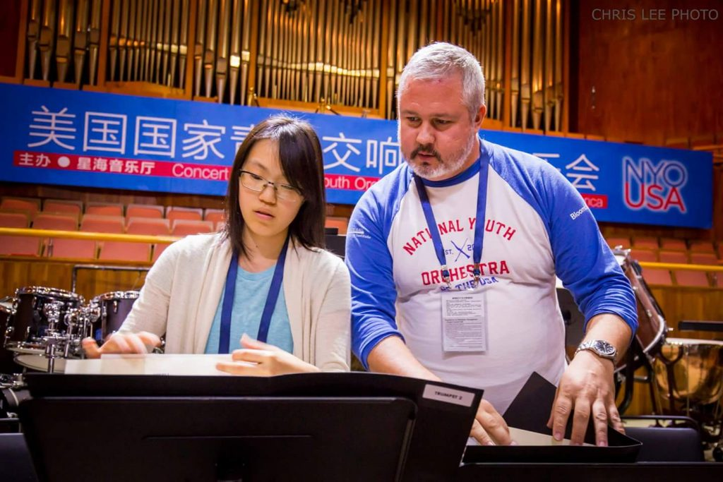 Nhyta Taguchi working with Paul Beck during the NYO-USA tour to China in 2015 (Photo: Chris Lee)