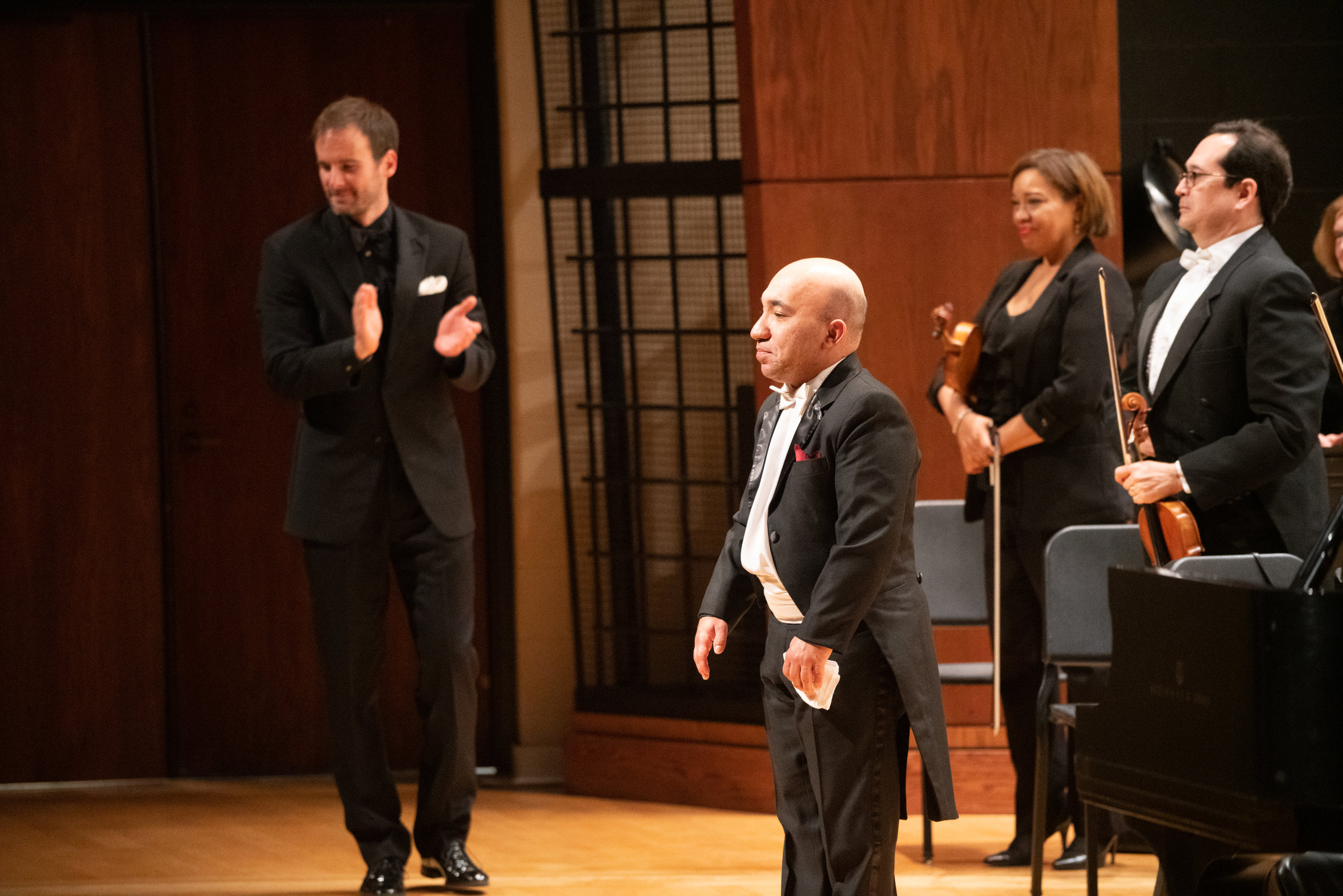 Guest Soloist Wael Farouk receives a standing ovation at the Lake Forest Symphony season closing concerts.