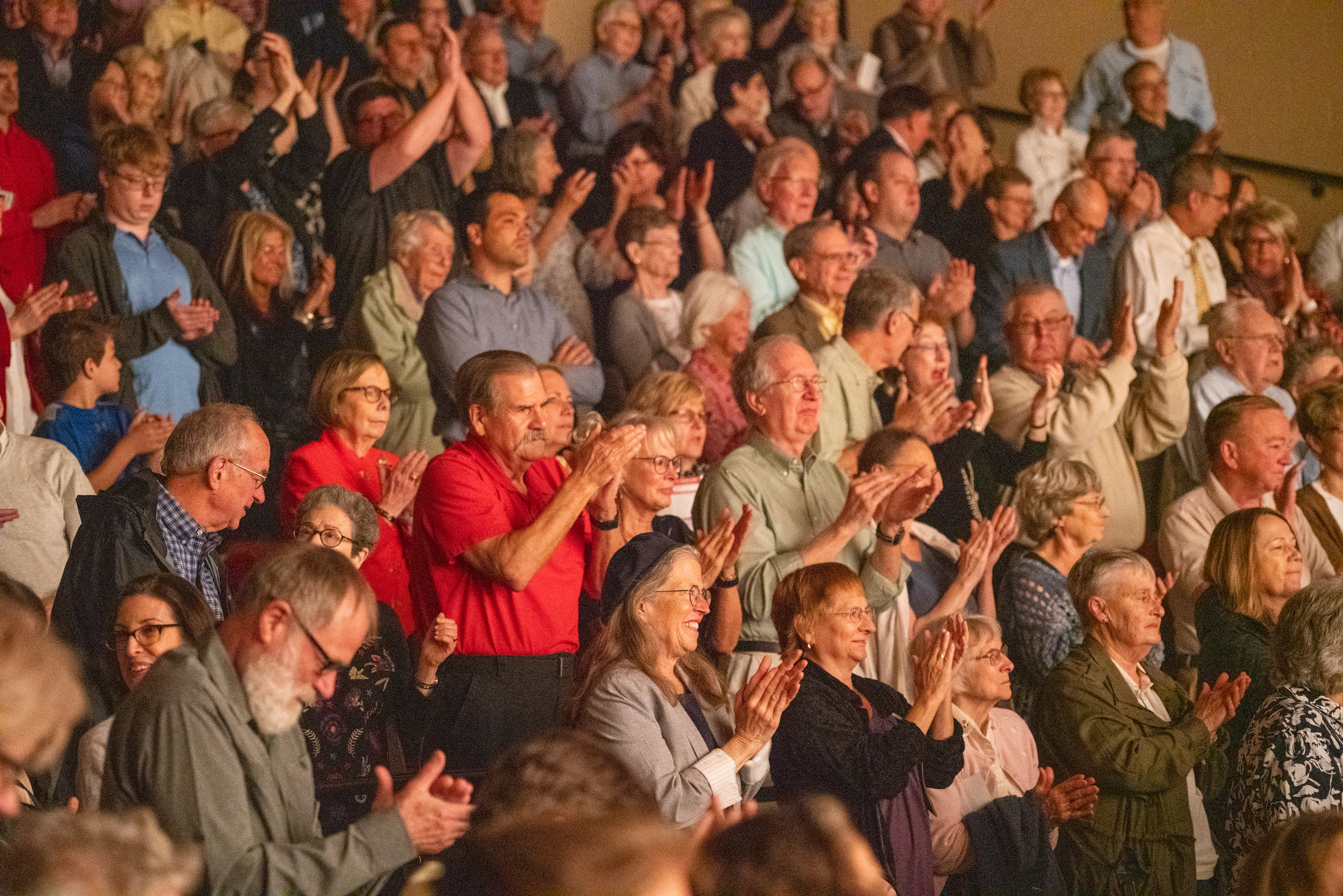 Audience members at the James Lumber Center cheer on the Lake Forest Symphony after an electrifying performance of Rachmaninov's Piano Concerto No. 3.