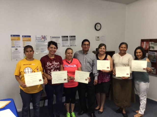 """The proud """"graduates"""" show off their certificates. They ended the final session with a wonderful potluck lunch and smiles all around. Many thanks to Jesus and Arcelia at Literacy Volunteers for partnering with Diamond Street Resource Center on our """"maiden voyage."""" Our next ESL classes begin in August and we are happy share that we will be offering morning and evening sessions! See the flyers  here  for more details."""
