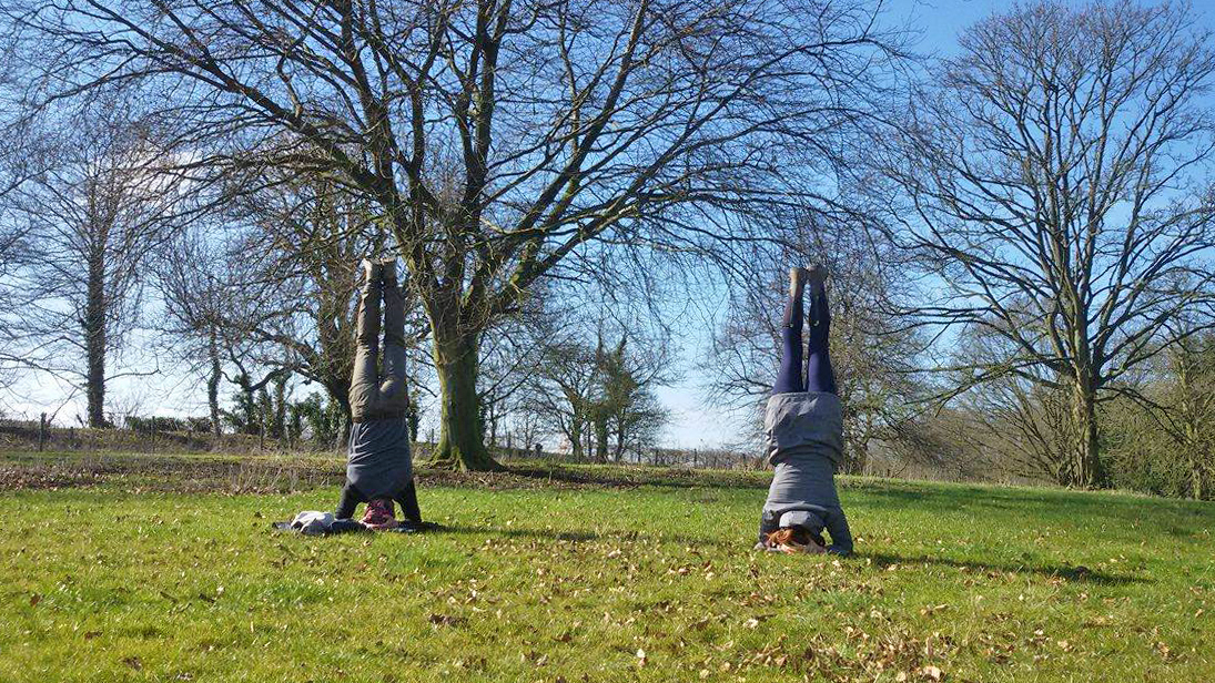 Spontaneous handstands in the fields with a fellow volunteer!