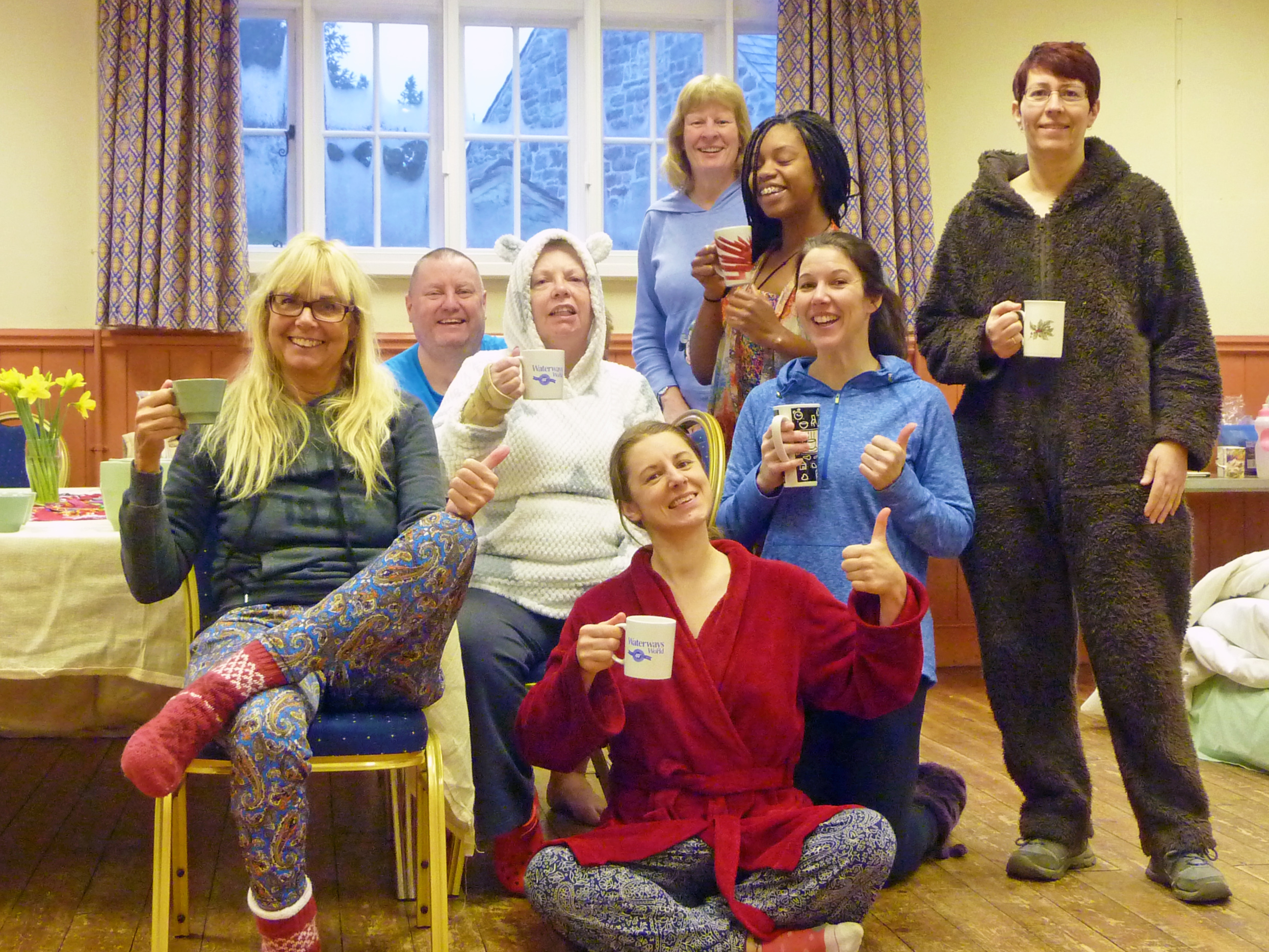 Here we all are in our PJ's and onesies... having just woken up, drinking mugs of hot lemon and ginger water before morning yoga! ha ha