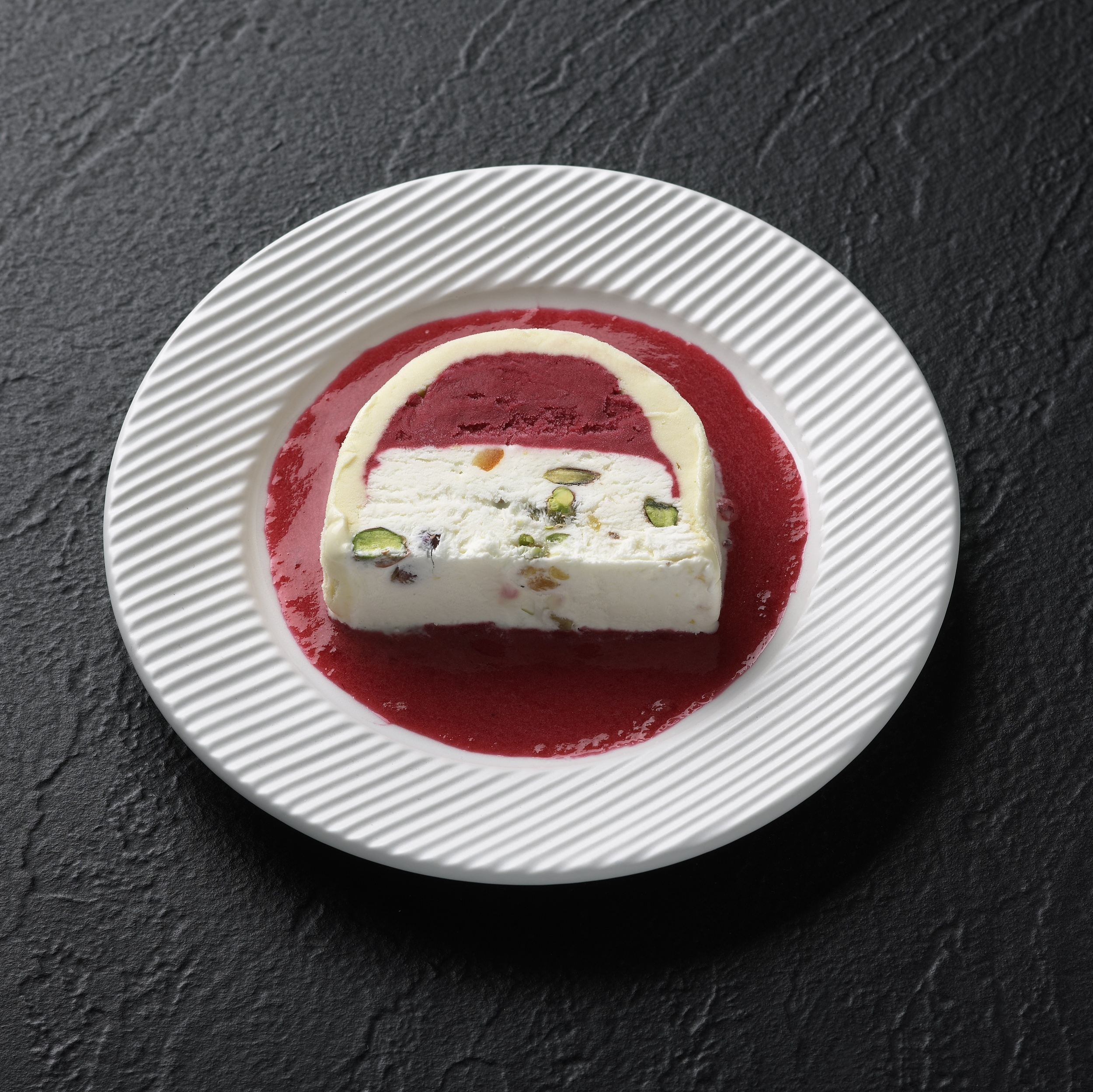 Cassata with Milanese Vanilla, Raspberry sorbet, whipped cream and candied pistachios