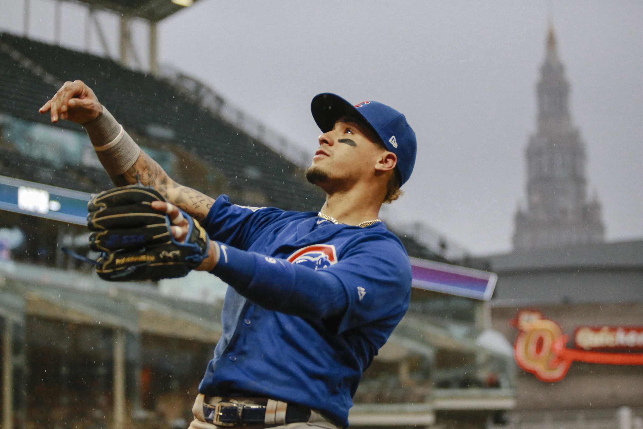 Javier Baez throws a ball into the crowd at the conclusion of the inning during the first matchup between the Cubs and Indians since the 2016 World Series.