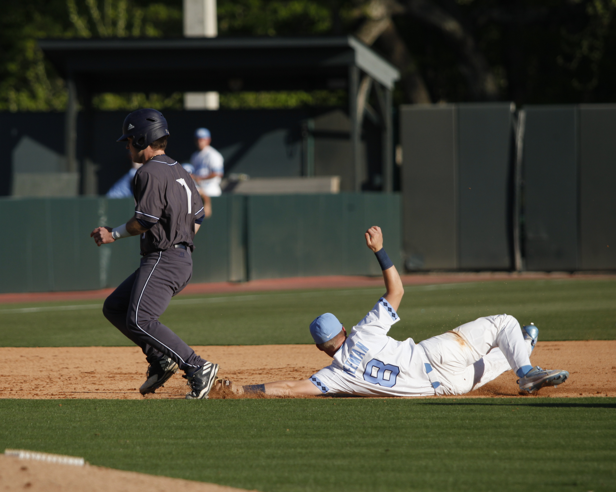 UNC shortstop, Ike Freeman, dives to get the out during a pickle play between second and third base at Boshamer Stadium.