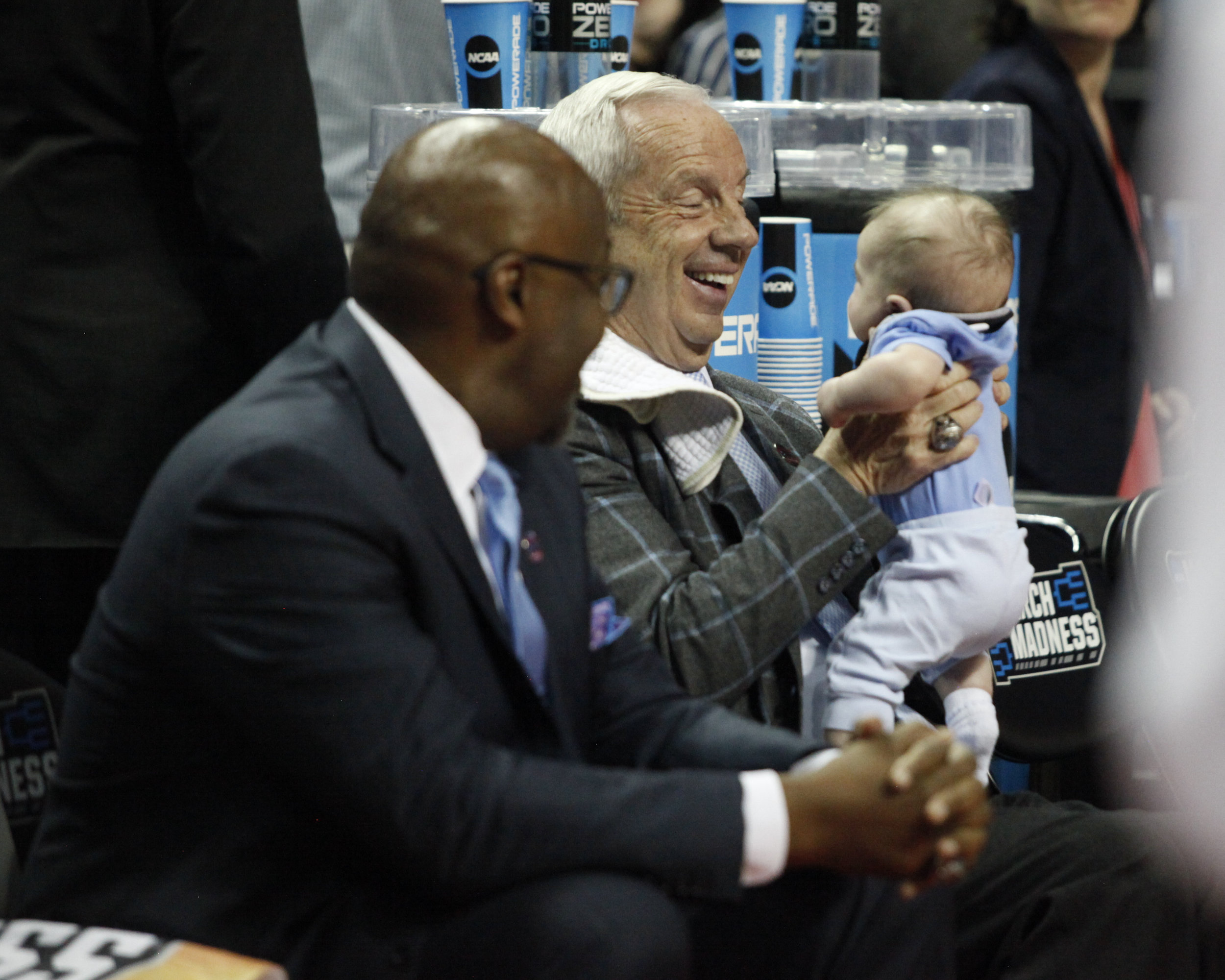 Coach Roy Williams smiles at his grandson Kayson Newlin before the game against Texas A&M.